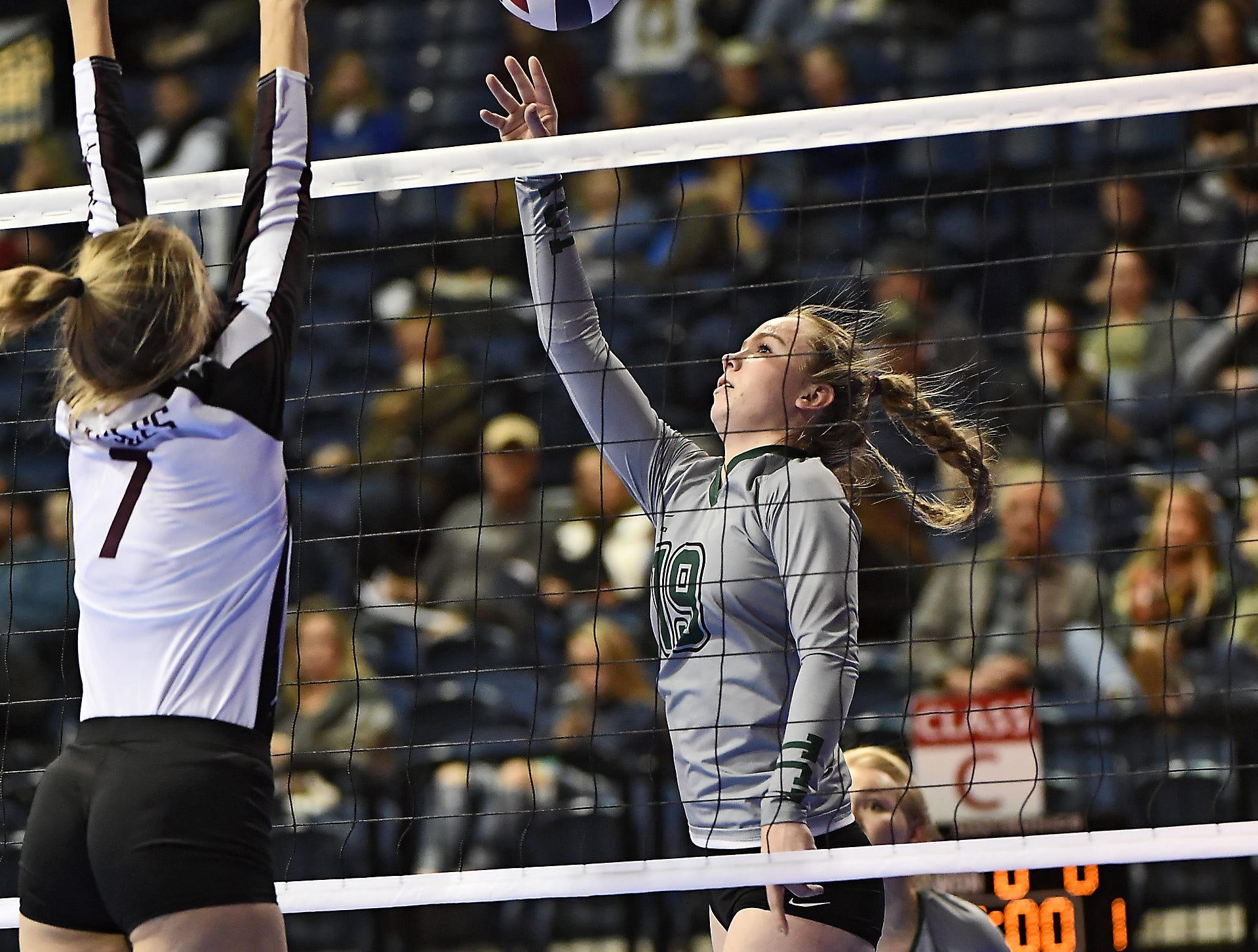 Brianna Bergum of Tri-Cities tips the ball in a match with Manhattan Christian at the All-Class State Volleyball Tournament at the Brick Breeden Fieldhouse in Bozeman Friday.