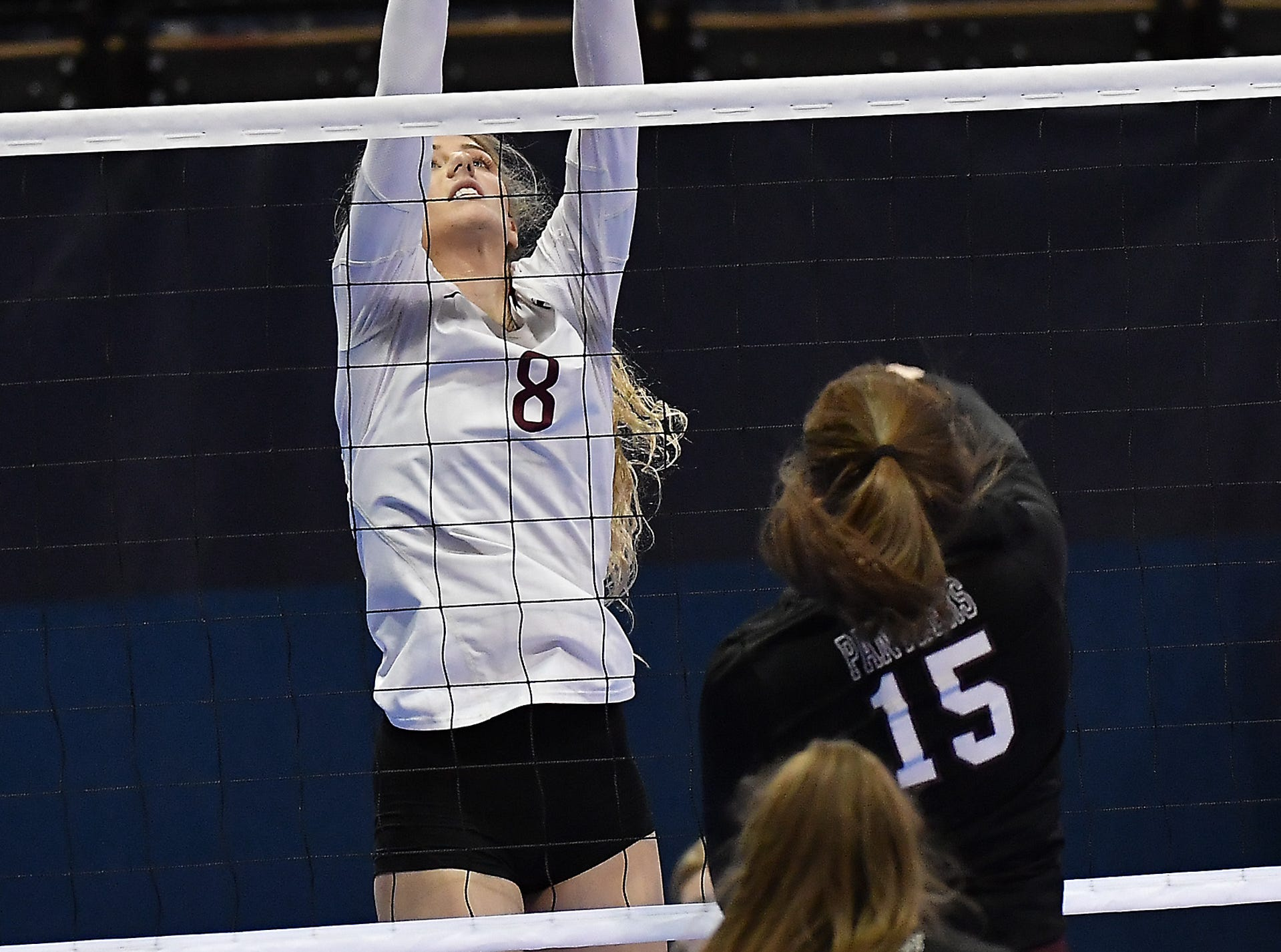 Abby Juve of Wolf Point records a block in a match with Roundup at the All-Class State Volleyball Tournament at the Brick Breeden Fieldhouse in Bozeman Friday.