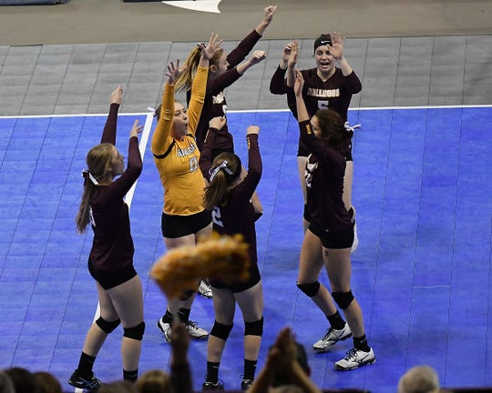The Choteau Bulldogs celebrate a point against Fairfield at the All-Class State Volleyball Tournament at the Brick Breeden Fieldhouse in Bozeman Friday.