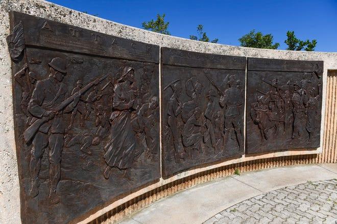 Historic plaques commemorating Guam during World War ll the decorate walls at the Asan Bay Overlook on Nimitz Hill, Nov. 10, 2018.
