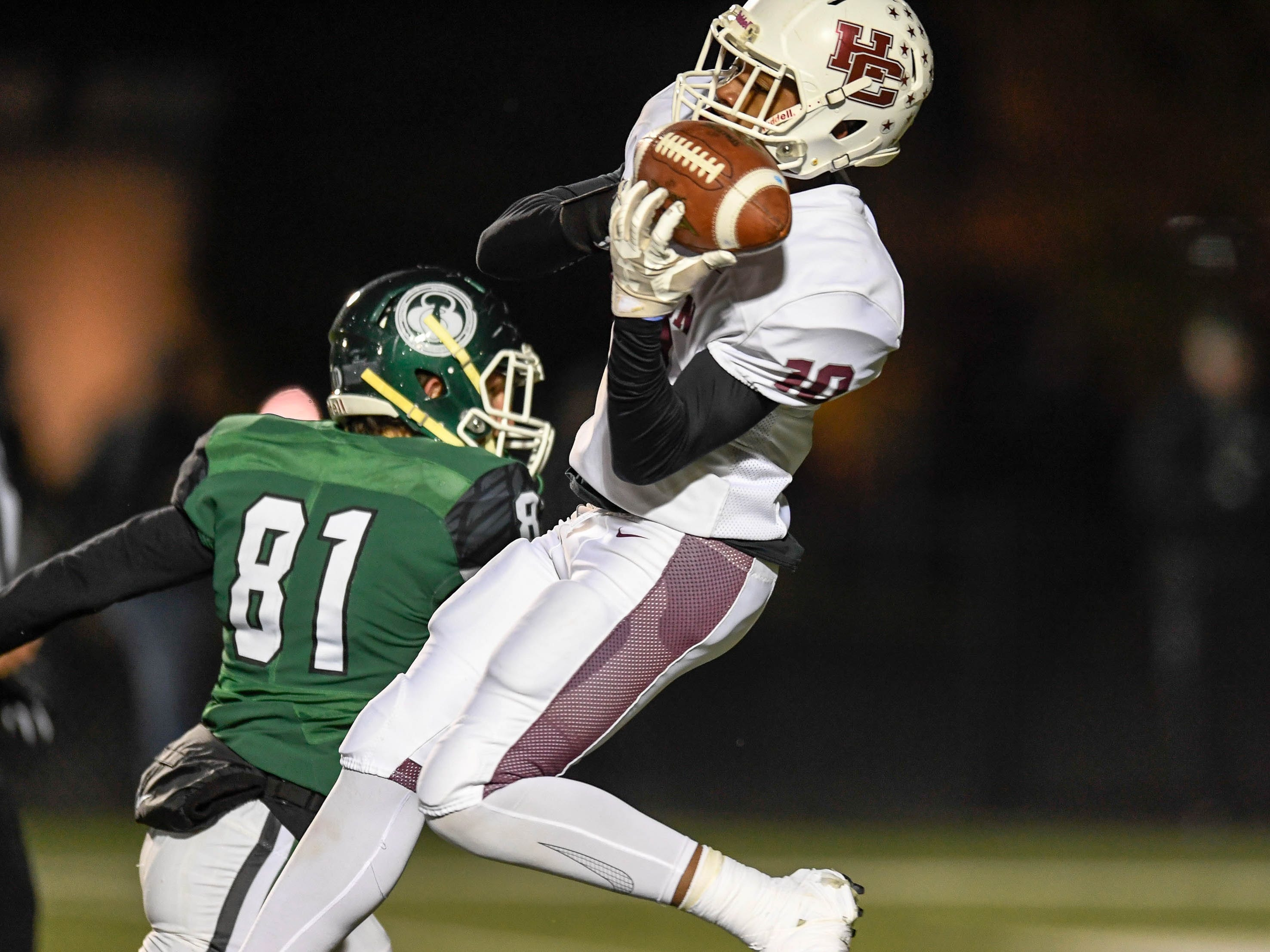 Henderson's Daymian Dixon (10) catches a touchdown pass as the Henderson County Colonels play the Trinity Shamrocks in the second round of the Class 6-A football playoffs at Marshall Stadium in Louisville Friday, November 9, 2018.