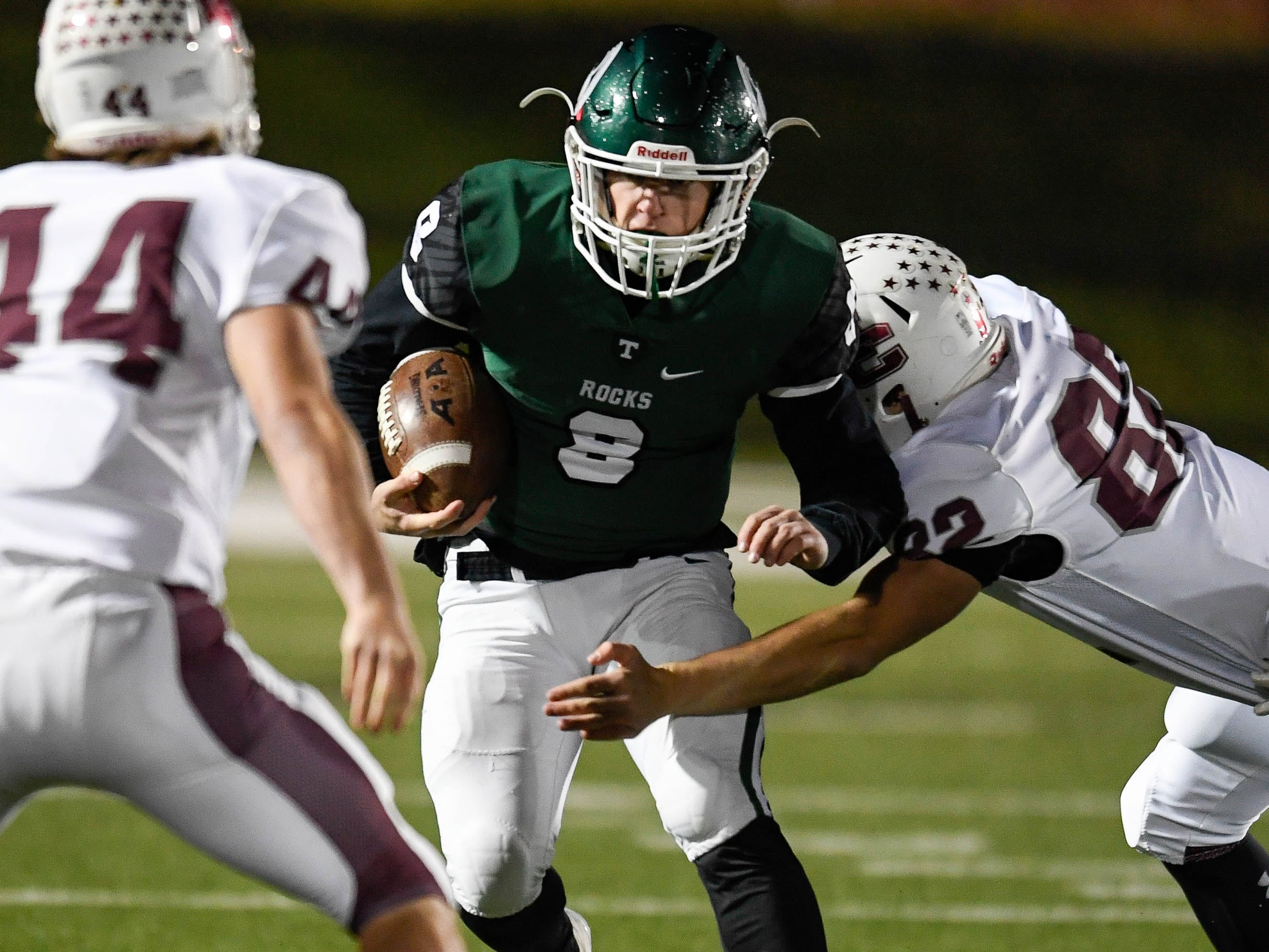 Henderson's Jackson Hogg (82)  and Jack McLevain (44) wrap up Trinity's Jake McKean (8) as the Henderson County Colonels play the Trinity Shamrocks in the second round of the Class 6-A football playoffs at Marshall Stadium in Louisville Friday, November 9, 2018.
