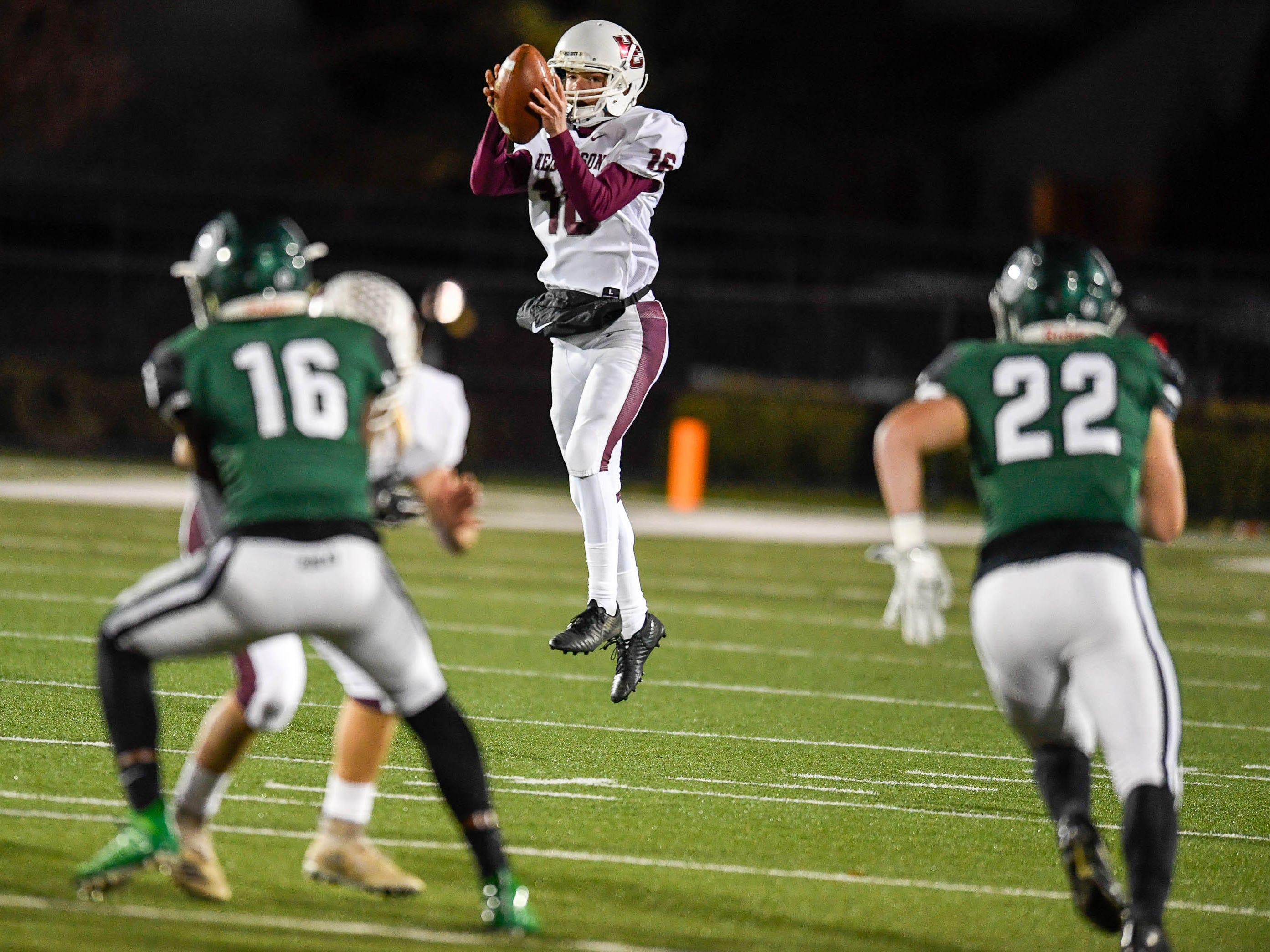Henderson's Colton Evans (16) takes a high snap for a punt as the Henderson County Colonels play the Trinity Shamrocks in the second round of the Class 6-A football playoffs at Marshall Stadium in Louisville Friday, November 9, 2018.