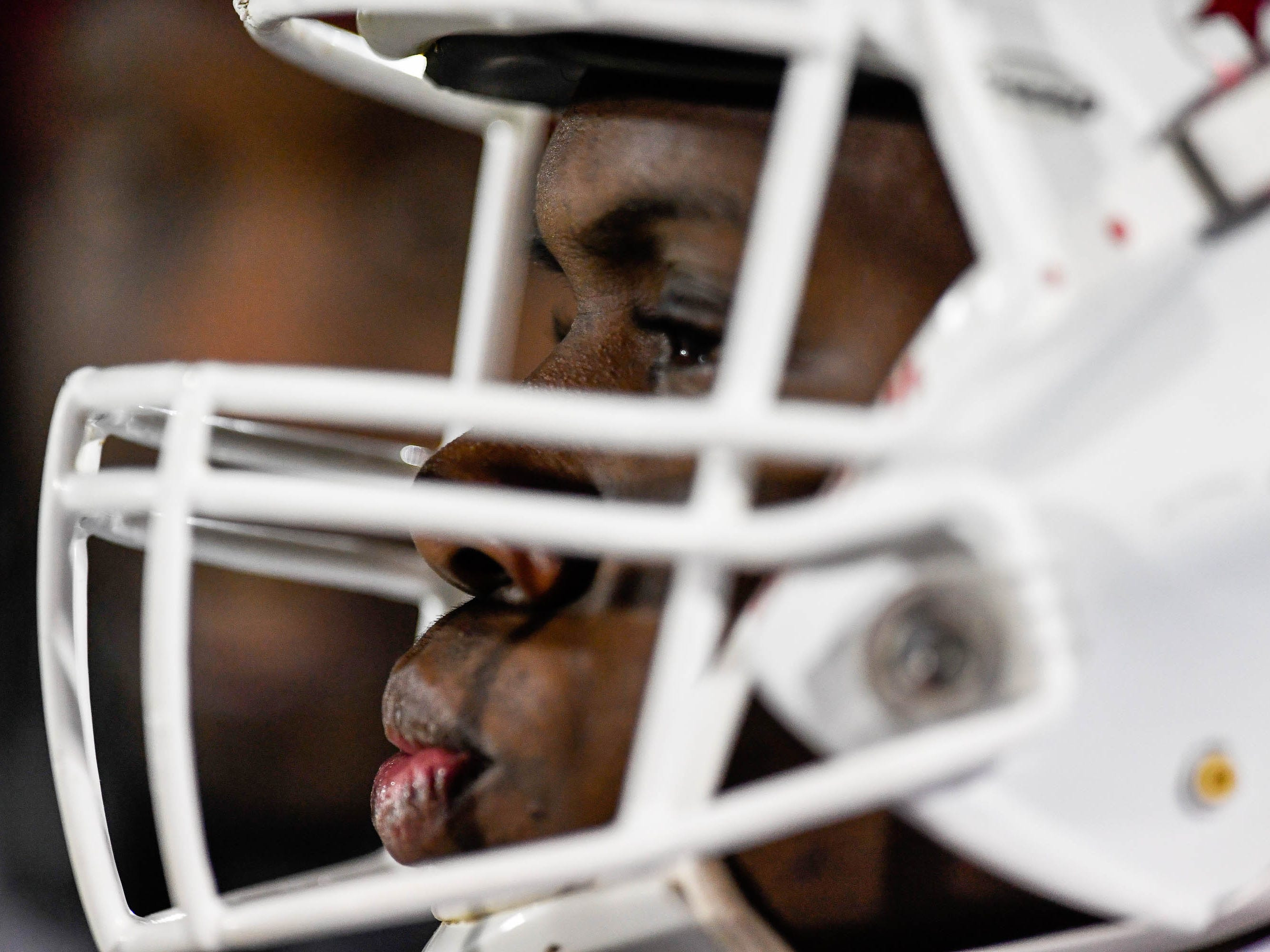 Henderson quarterback Skip Patterson (1)  watches the defense play as the Henderson County Colonels play the Trinity Shamrocks in the second round of the Class 6-A football playoffs at Marshall Stadium in Louisville Friday, November 9, 2018.
