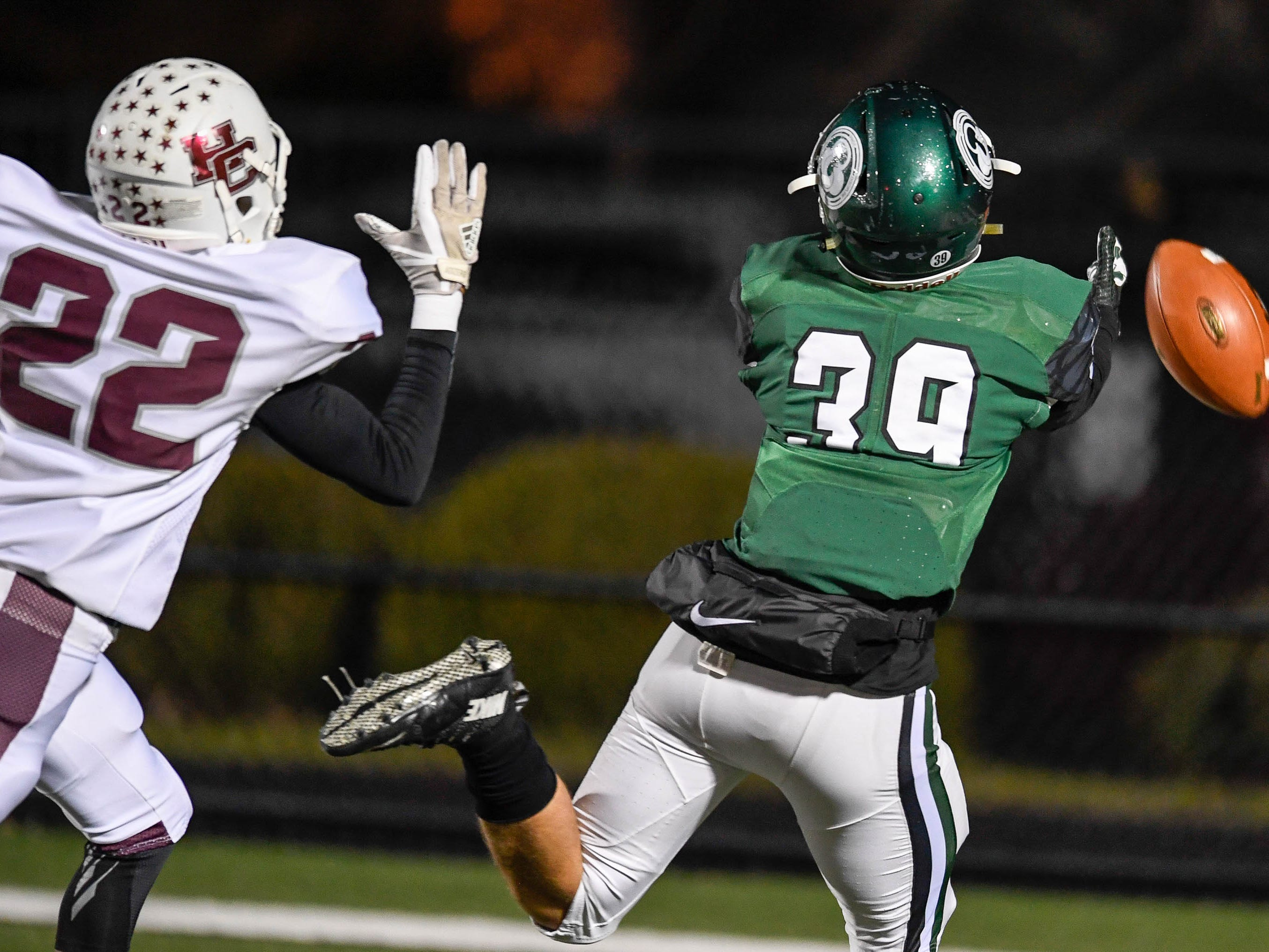 An incomplete pass to Trinity's Ryan Miller (39 under pressure from Henderson's Edmund Brooks (22) )as the Henderson County Colonels play the Trinity Shamrocks in the second round of the Class 6-A football playoffs at Marshall Stadium in Louisville Friday, November 9, 2018.