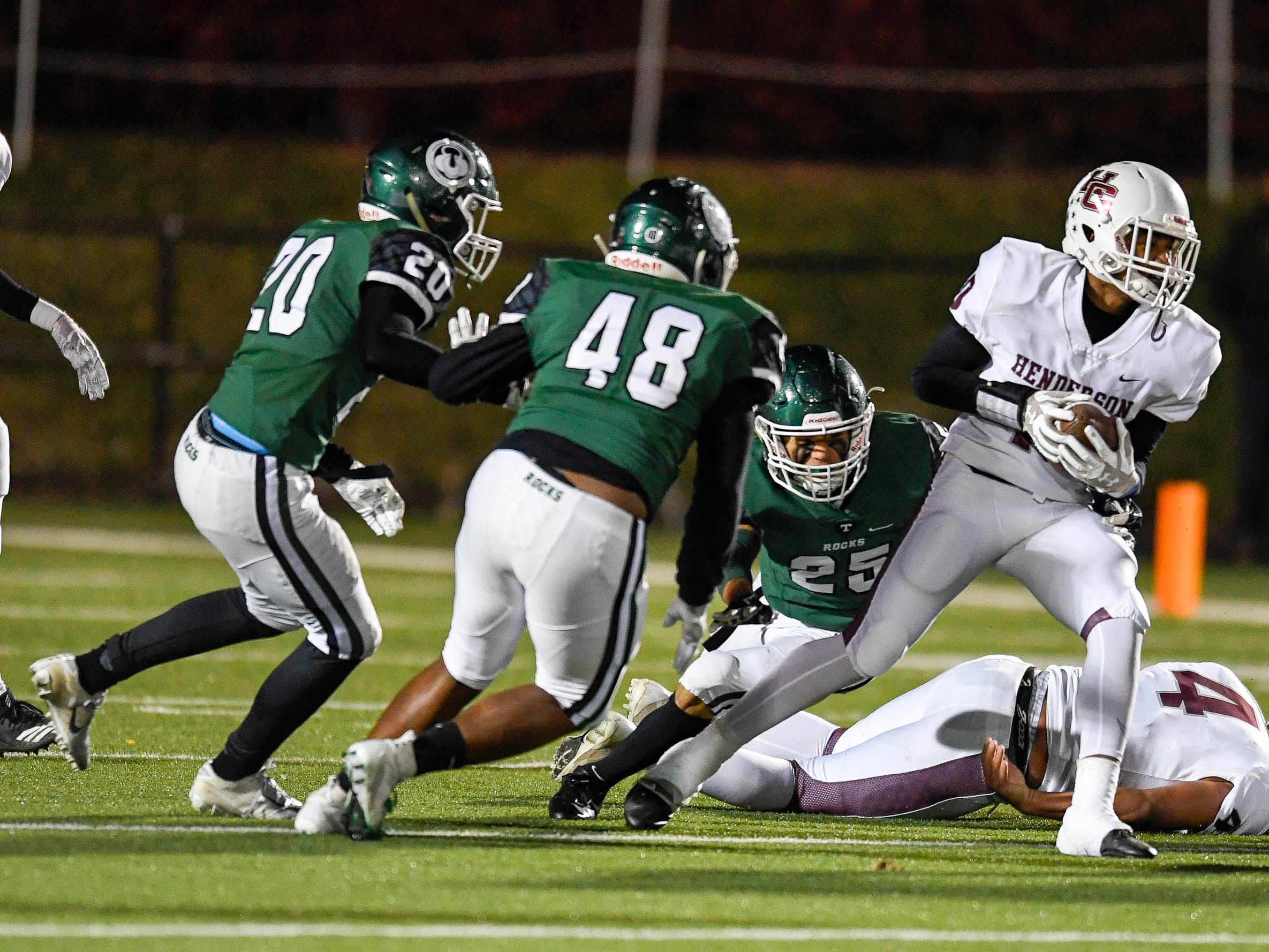 Henderson's Daymian Dixon (10) looks for yardage as the Henderson County Colonels play the Trinity Shamrocks in the second round of the Class 6-A football playoffs at Marshall Stadium in Louisville Friday, November 9, 2018.