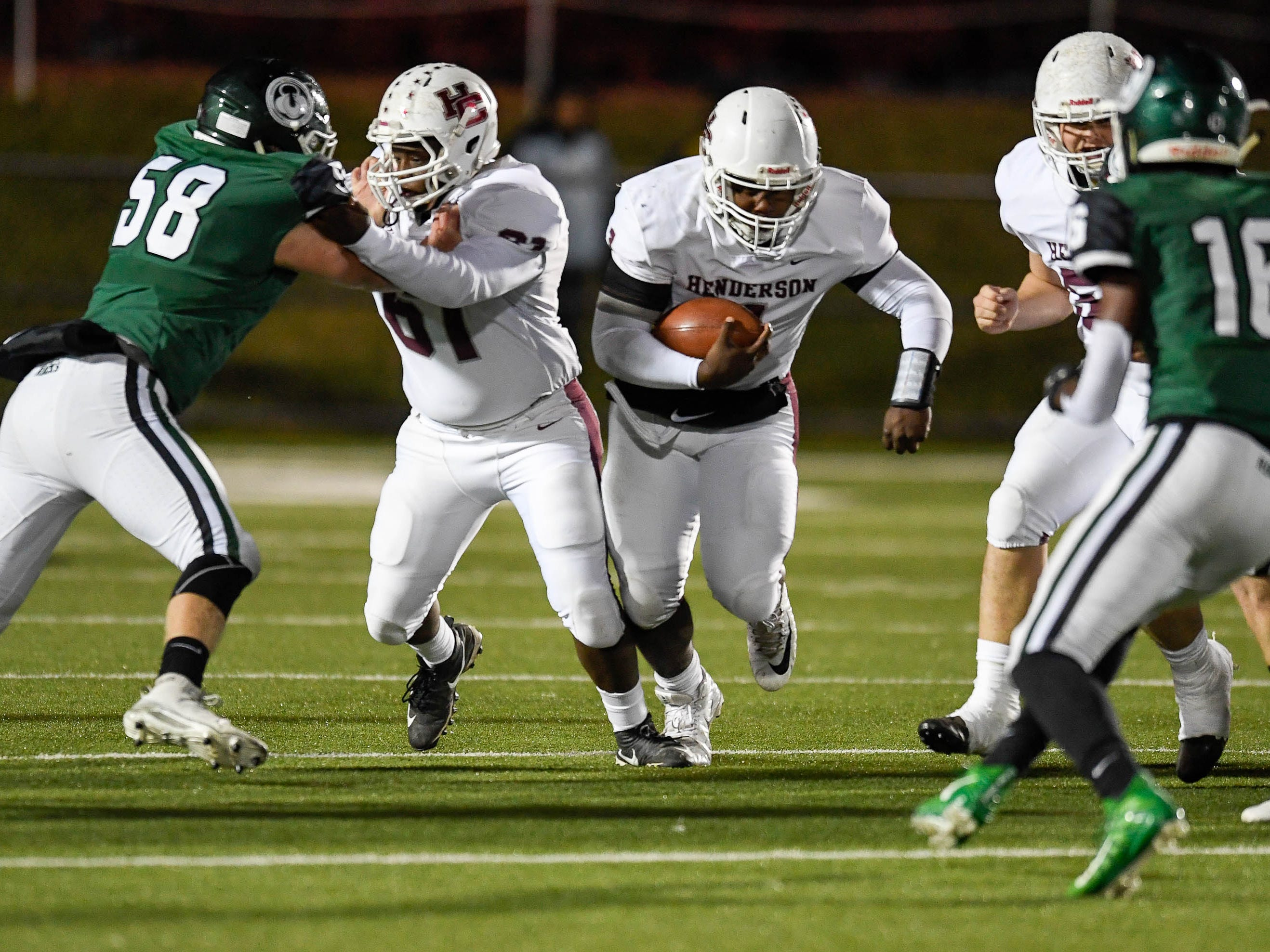 Henderson quarterback Skip Patterson (1) runs a keeper as the Henderson County Colonels play the Trinity Shamrocks in the second round of the Class 6-A football playoffs at Marshall Stadium in Louisville Friday, November 9, 2018.