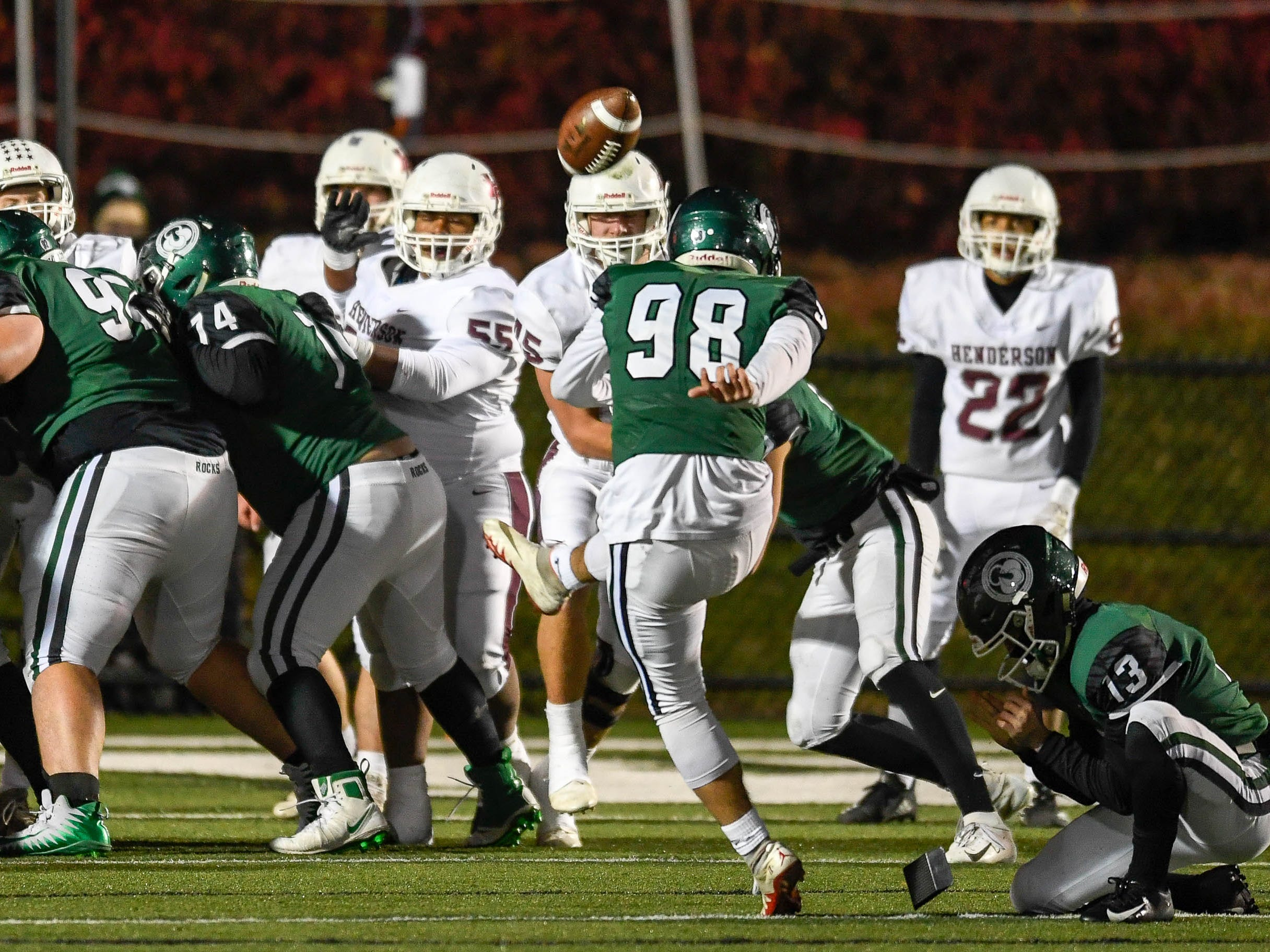 Trinity's Sebastian Mata (98) kicks a extra point as the Henderson County Colonels play the Trinity Shamrocks in the second round of the Class 6-A football playoffs at Marshall Stadium in Louisville Friday, November 9, 2018.
