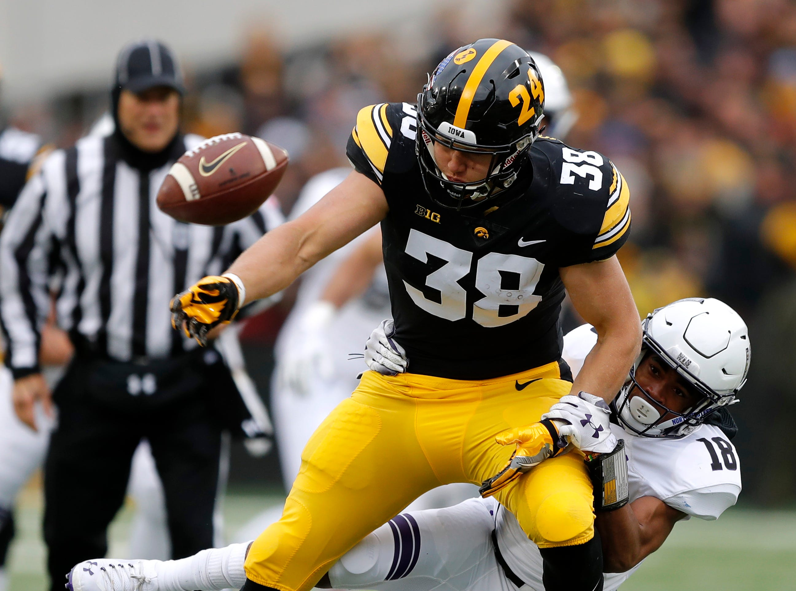 Northwestern defensive back Cameron Ruiz (18) breaks up a pass intended for Iowa tight end T.J. Hockenson (38) during the first half of an NCAA college football game, Saturday, Nov. 10, 2018, in Iowa City, Iowa. (AP Photo/Charlie Neibergall)