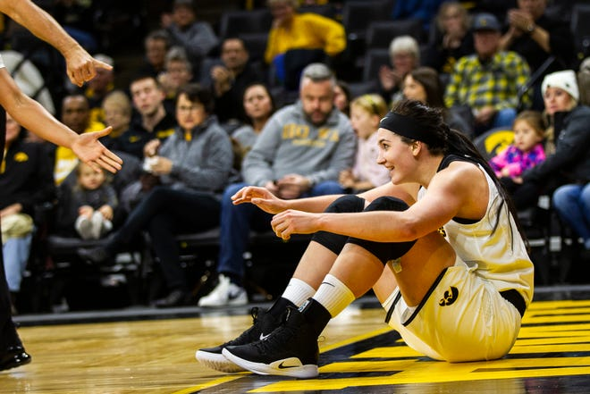 Iowa forward Megan Gustafson (10) smiles after making a basket while being fouled in the paint during a women's NCAA basketball game on Friday, Nov. 9, 2018, at Carver-Hawkeye Arena in Iowa City.