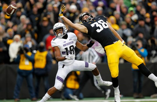Northwestern defensive back Cameron Ruiz (18) breaks up a pass intended for Iowa tight end T.J. Hockenson (38) during the first half of an NCAA college football game, Saturday, Nov. 10, 2018, in Iowa City, Iowa.