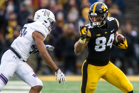 Iowa wide receiver Nick Easley (84) evades Northwestern's Cameron Ruiz (18) during a Big Ten Conference football game on Saturday, Nov. 10, 2018, at Kinnick Stadium in Iowa City.