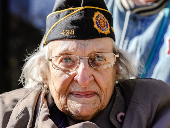 Korean War navy veteran Ruth Dooley cracks a smile during the Veterans Day Parade on Saturday.