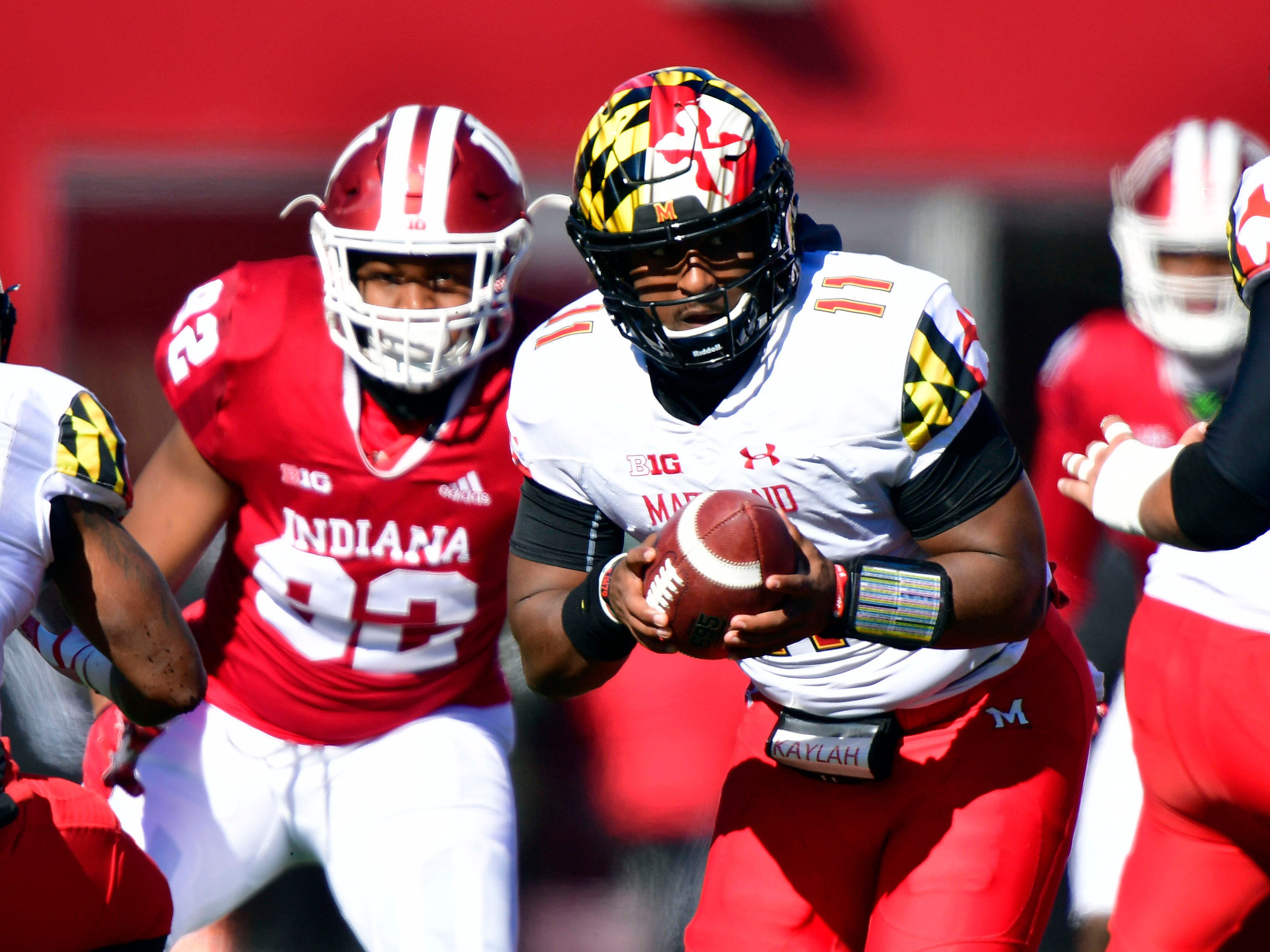 Maryland Terrapins quarterback Kasim Hill (11) looks for a teammate during the fist half of the the game against the Indiana Hoosiers at Memorial Stadium .