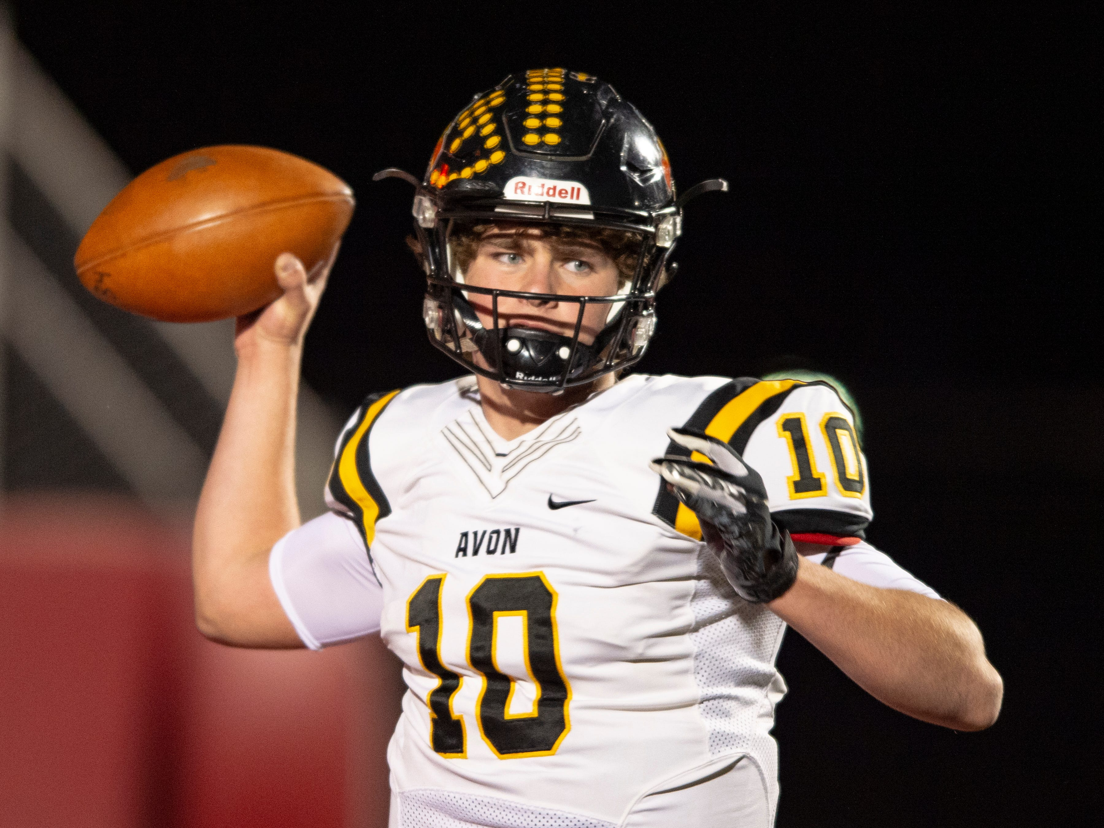 Avon High School sophomore Henry Hesson (10) drops back to throw out of the backfield during the first half of action. Center Grove High School hosted Avon High School in an IHSAA Class 6A Regional Championship varsity football game, Friday, Nov. 9, 2018.
