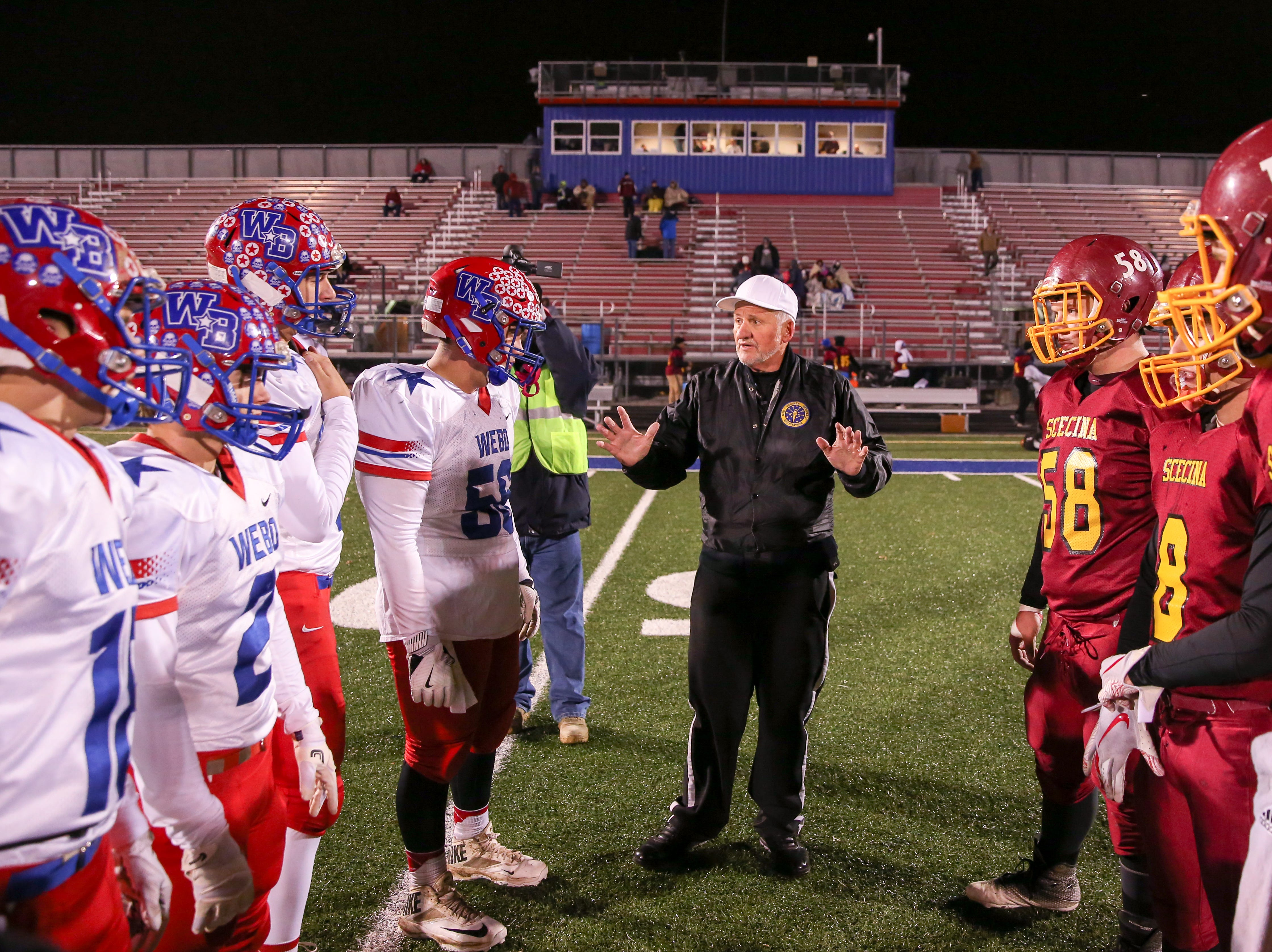 Team captains meet for the coin toss for the start of Indianapolis Scecina vs Western Boone High School varsity football in the Class 2A Regional Championship held at Roncalli High School, Friday, November 9, 2018.
