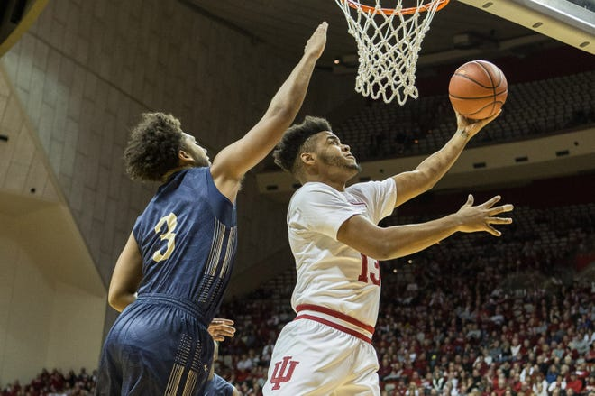Hoosiers forward Juwan Morgan (13) shoots the ball while Montana State Bobcats guard Tyler Hall (3) defends in the first half at Assembly Hall.