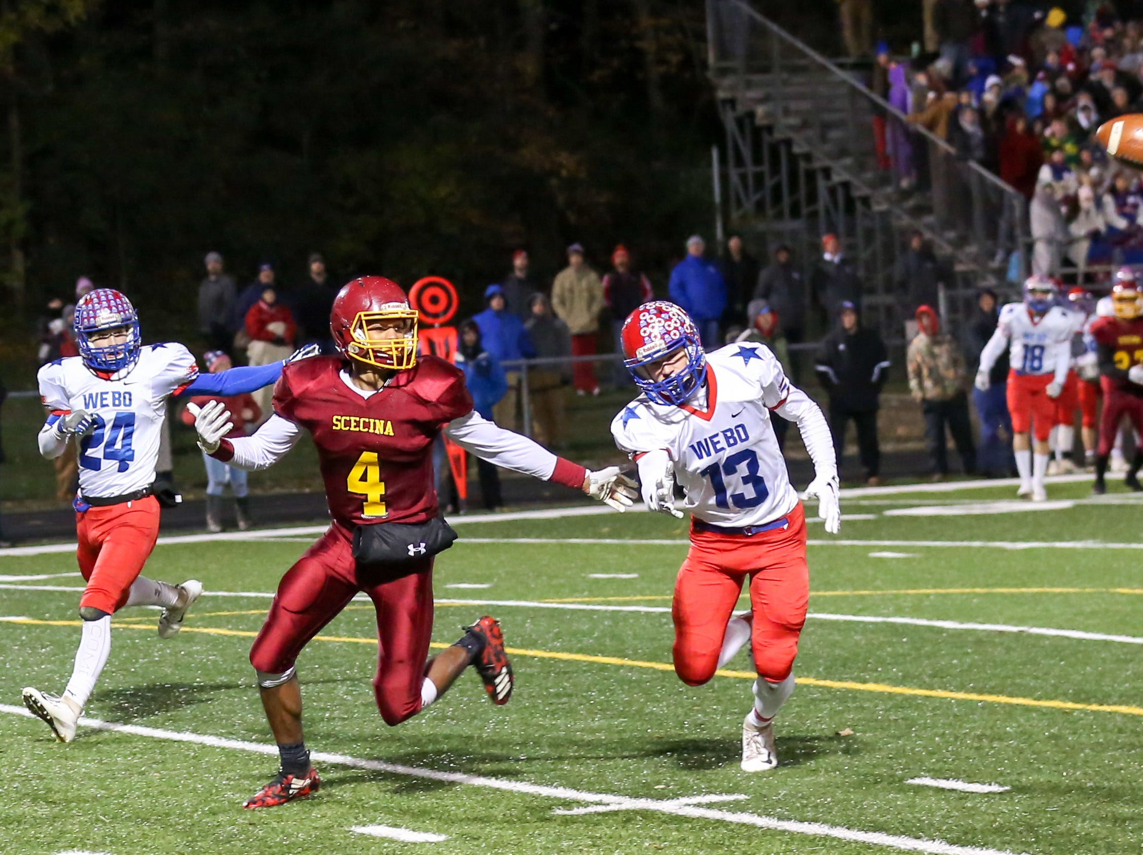 Scecina's David Baker (4) cannot reach the ball on this pass attempt during the first half of Indianapolis Scecina vs Western Boone High School varsity football in the Class 2A Regional Championship held at Roncalli High School, Friday, November 9, 2018.