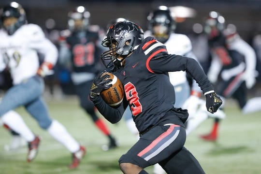 North Central High School Panthers Tre'von Elliott (9) runs the ball during a regional finals game against the against the Warren Central High School Warriors at North Central High School on Friday, Nov. 9, 2018.