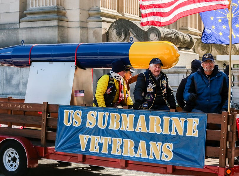 Veterans ride in the Veterans Day Parade.