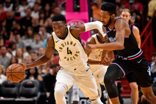 Nov 9, 2018; Miami, FL, USA; Indiana Pacers guard Victor Oladipo (4) dribbles the ball against Miami Heat forward Derrick Jones Jr. (5) during the first half at American Airlines Arena. Mandatory Credit: Jasen Vinlove-USA TODAY Sports
