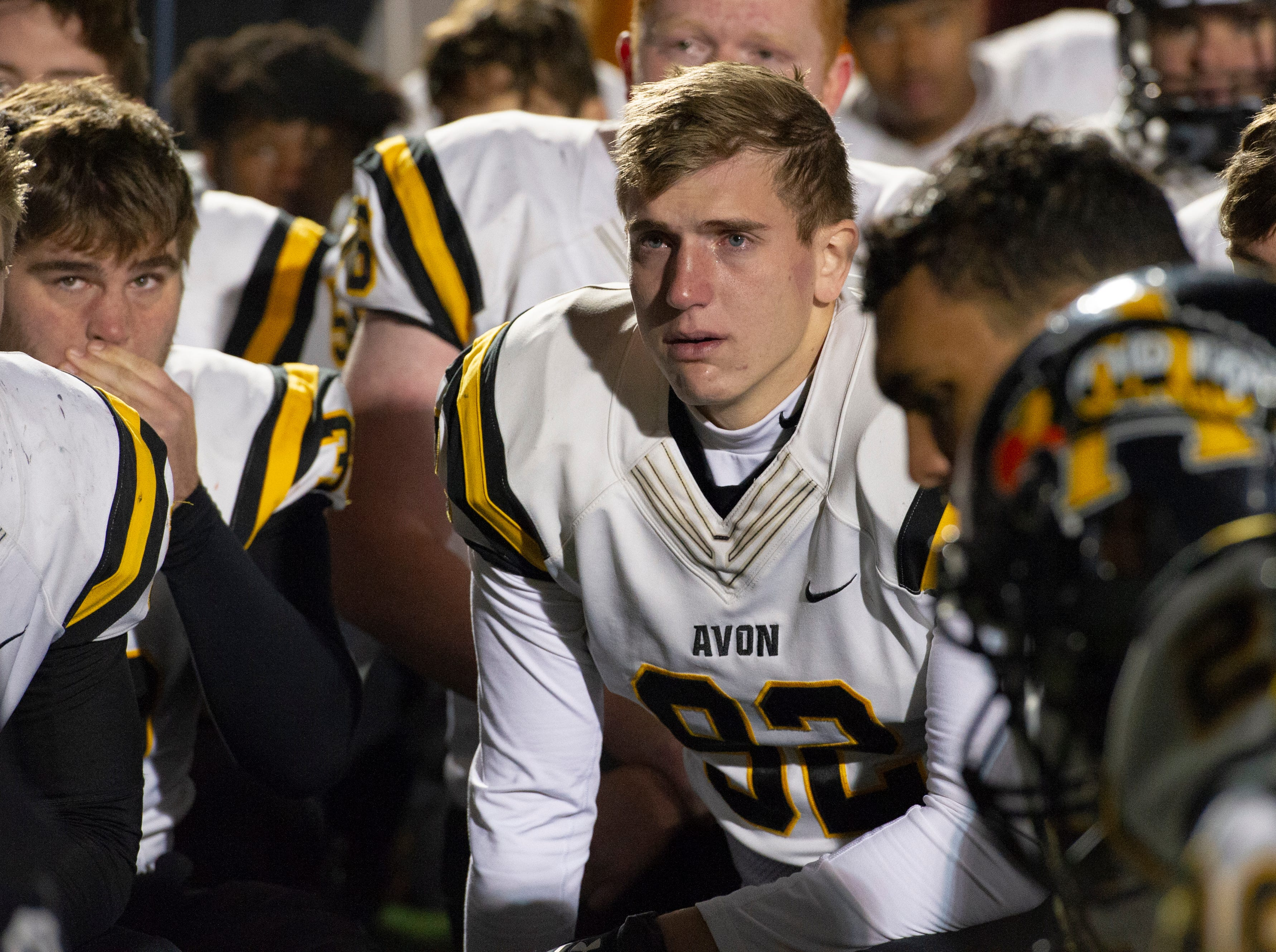 Avon High School senior Connor Wakefield (92) and other players react to the team's loss. Center Grove High School hosted Avon High School in an IHSAA Class 6A Regional Championship varsity football game, Friday, Nov. 9, 2018. Center Grove won 17-0 to advance to semi-state.
