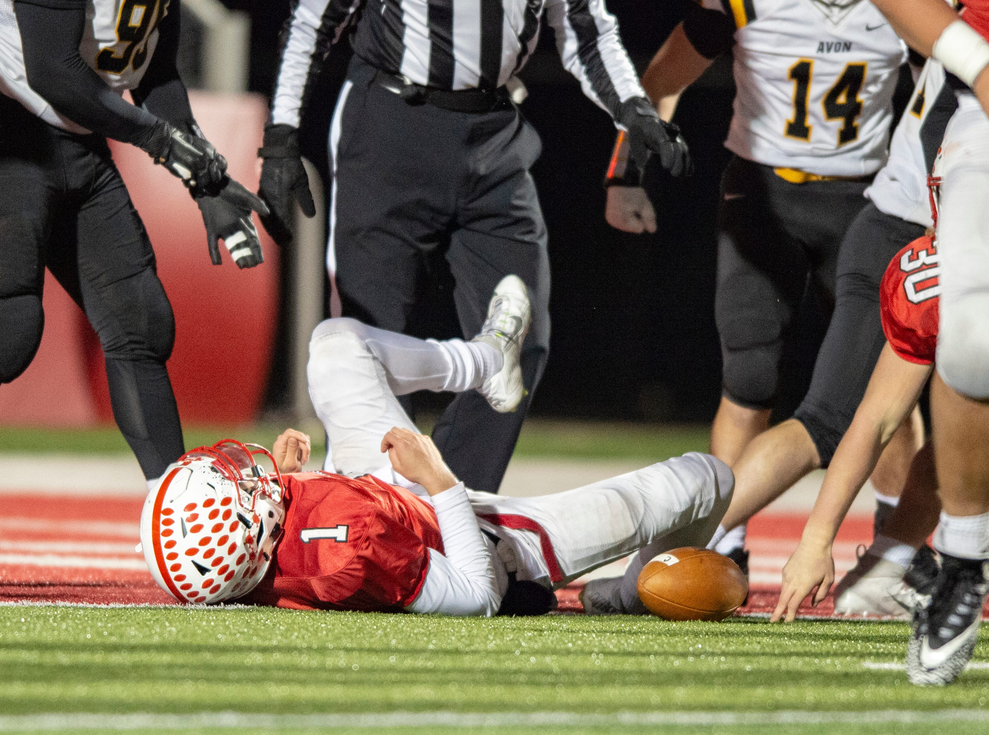 Center Grove High School senior Jack Moore (1) reacts after sophomore Carson Steele (30) failed to rush the ball into the end zone during the first half of action. Center Grove High School hosted Avon High School in an IHSAA Class 6A Regional Championship varsity football game, Friday, Nov. 9, 2018.