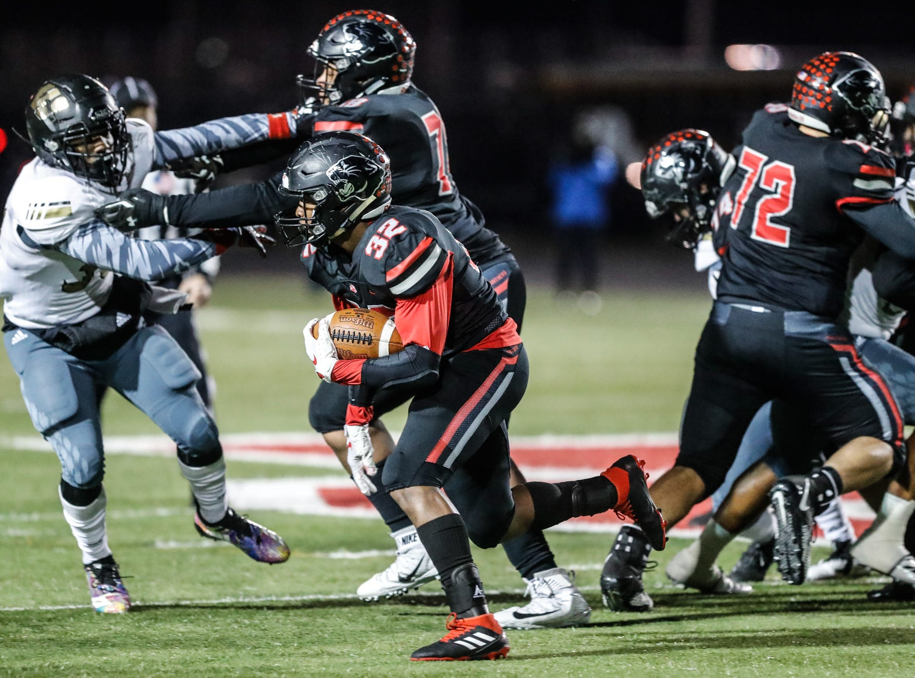 North Central High School Panthers running back Alexander Tarver (32) runs the ball during a regional finals game against the against the Warren Central High School Warriors at North Central High School on Friday, Nov. 9, 2018.