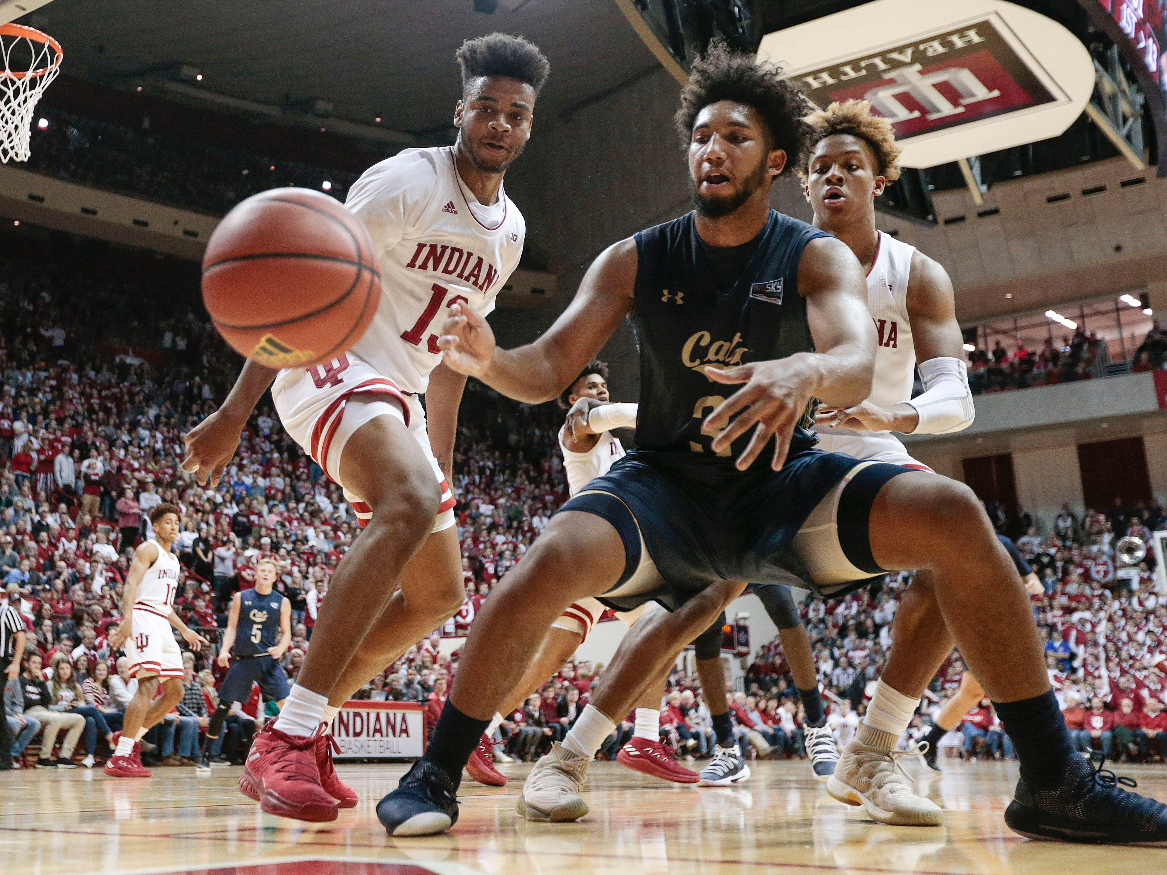 Montana State guard Tyler Hall, center, lets the ball go out of bounds in front of Indiana defenders Juwan Morgan, left, and Romeo Langford during the first half of an NCAA college basketball game in Bloomington, Ind., Friday, Nov. 9, 2018. (AP Photo/AJ Mast)
