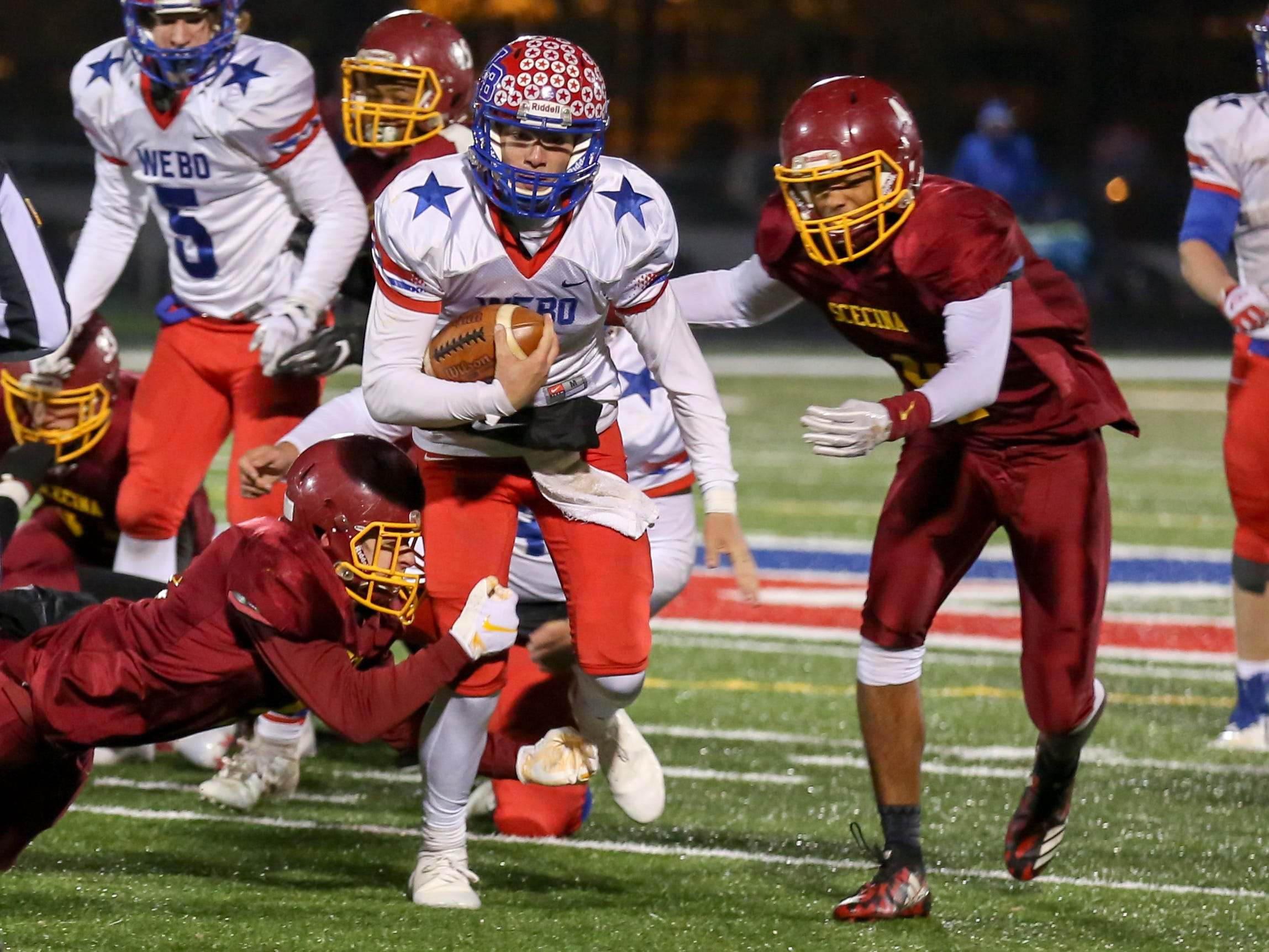 Western Boone's Spencer Wright (7) cannot find an opening as he keeps the ball and runs during the second half of Indianapolis Scecina vs Western Boone High School varsity football in the Class 2A Regional Championship held at Roncalli High School, Friday, November 9, 2018.