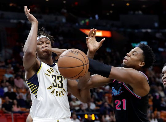 Miami Heat center Hassan Whiteside (21) loses the ball as Indiana Pacers center Myles Turner (33) defends during the second half of an NBA basketball game Friday, Nov. 9, 2018, in Miami. The Pacers won 110-102.
