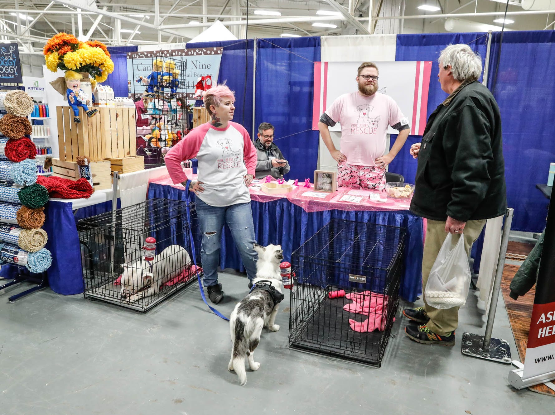 The Pink Heart Rescue crew mans their booth at the Great Indy Pet Expo, held at the Indiana State Fairgrounds on Sat. Nov. 10, 2018.