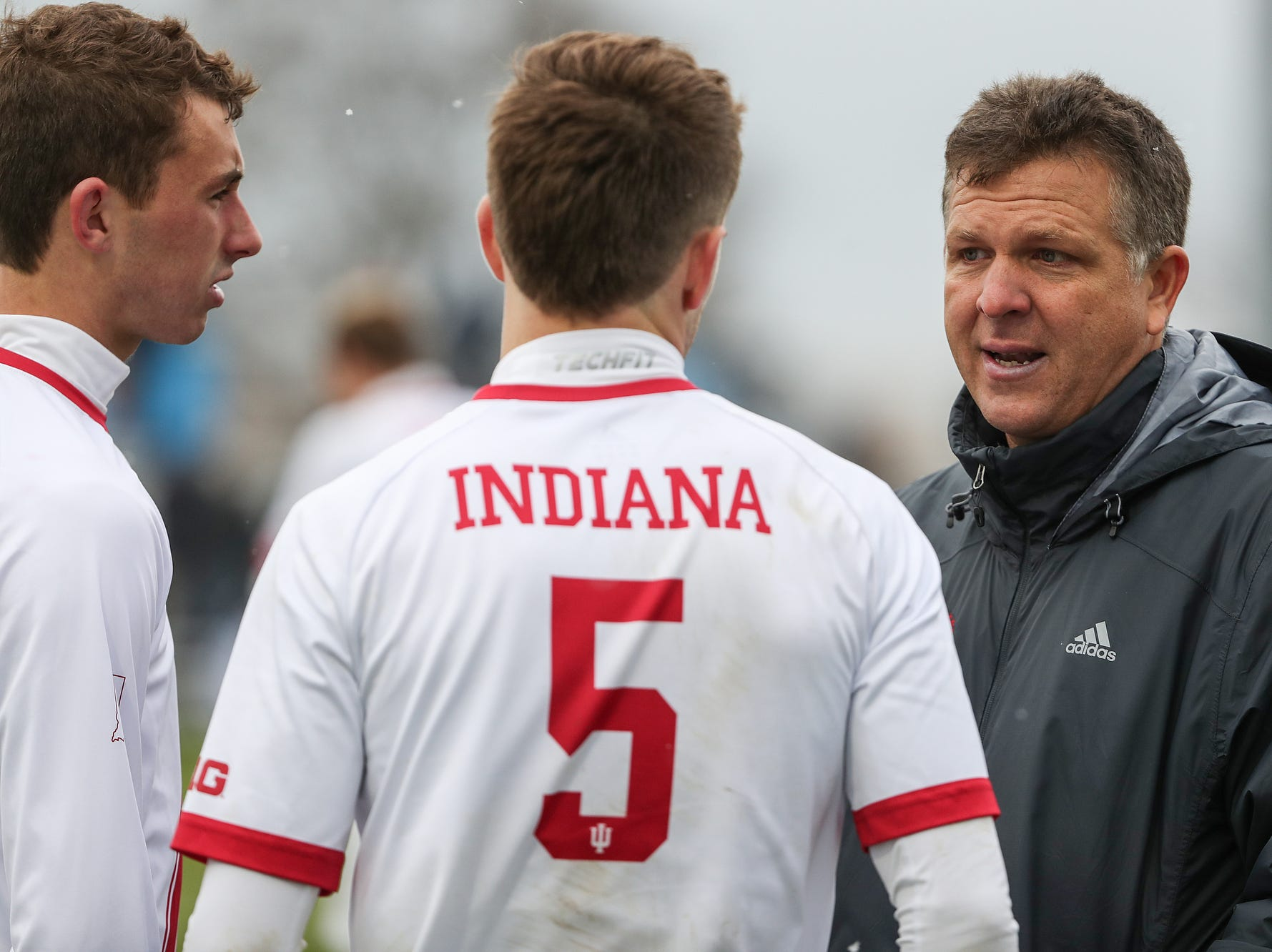 At right, Indiana Hoosiers head coach Todd Yeagley talks to players before going into overtime periods in Big Ten semifinals at Grand Park in Westfield, Ind., Friday, Nov. 9, 2018. Indiana and Maryland tied 1-1, with the Hoosiers advancing in penalty kicks, 4-3.