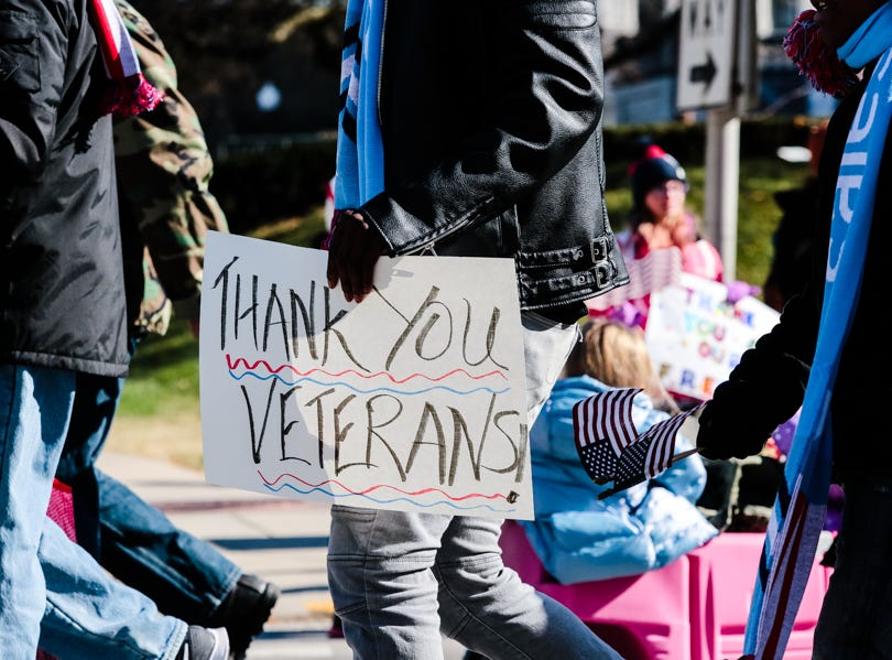 A sign supports veterans during the Veterans Day Parade.