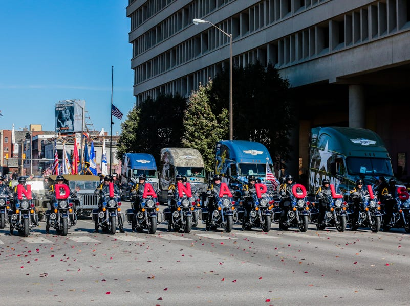 Motorcycles ride in the Veterans Day Parade.