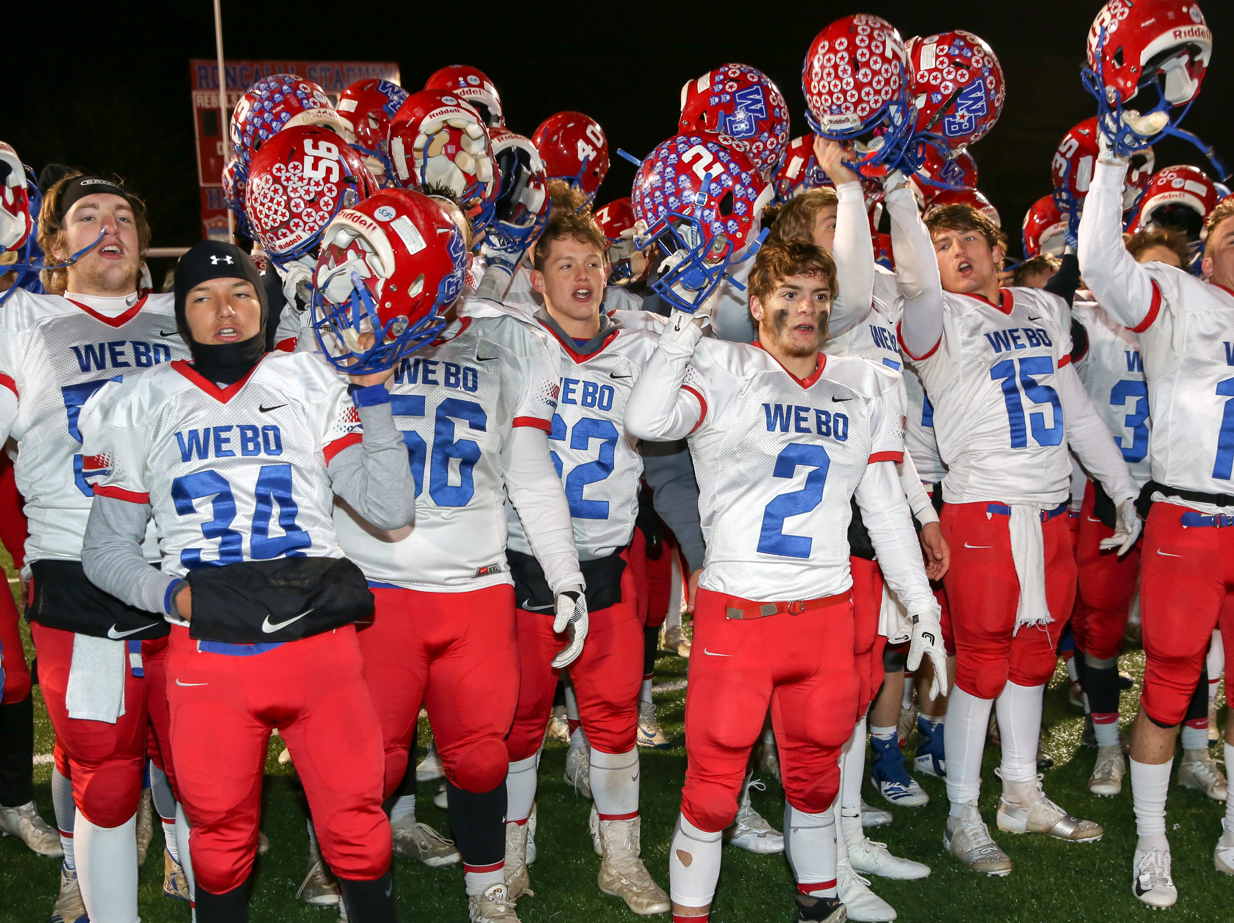Western Boone celebrate their 19-7 victory in the Indianapolis Scecina vs Western Boone High School varsity football in the Class 2A Regional Championship held at Roncalli High School, Friday, November 9, 2018.
