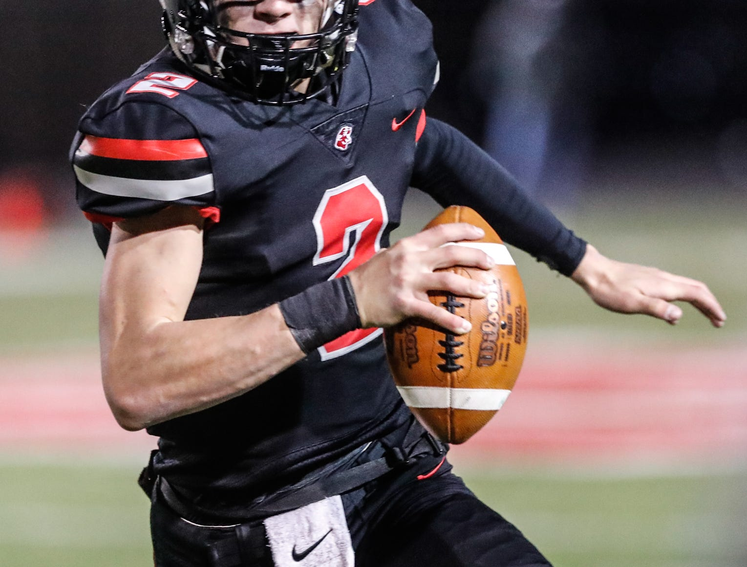 North Central High School Panther's Liam Thompson (2), runs the ball during a regional finals game against the Warren Central High School Warriors at North Central High School on Friday, Nov. 9, 2018.