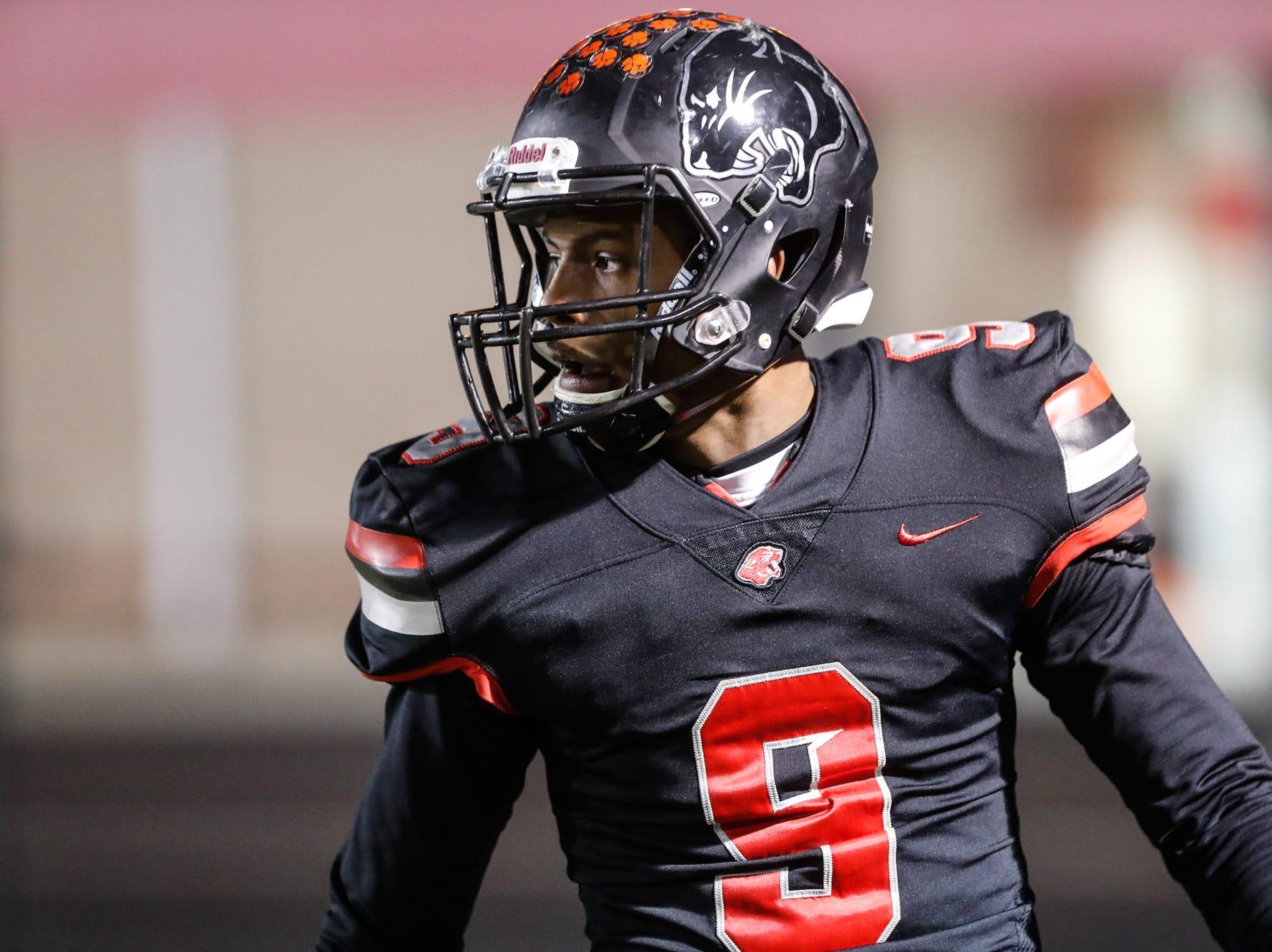 North Central High School Panthers Tre'von Elliott (9), celebrates a touchdown, during a regional finals game against the Warren Central High School Warriors at North Central High School on Friday, Nov. 9, 2018.