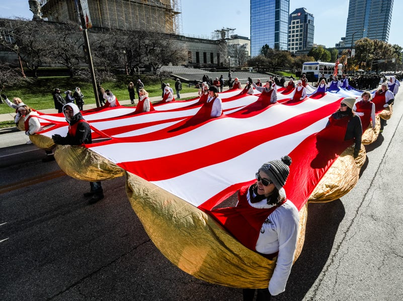 "The parade included this 28-person walking flag known as the OneAmerica ""Spirit of America."""