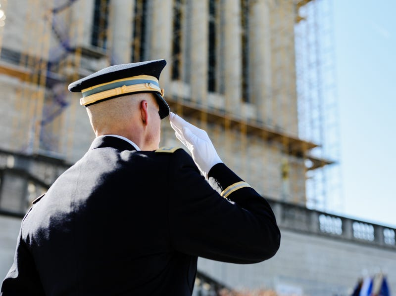 A man salutes during the Veterans Day Parade.