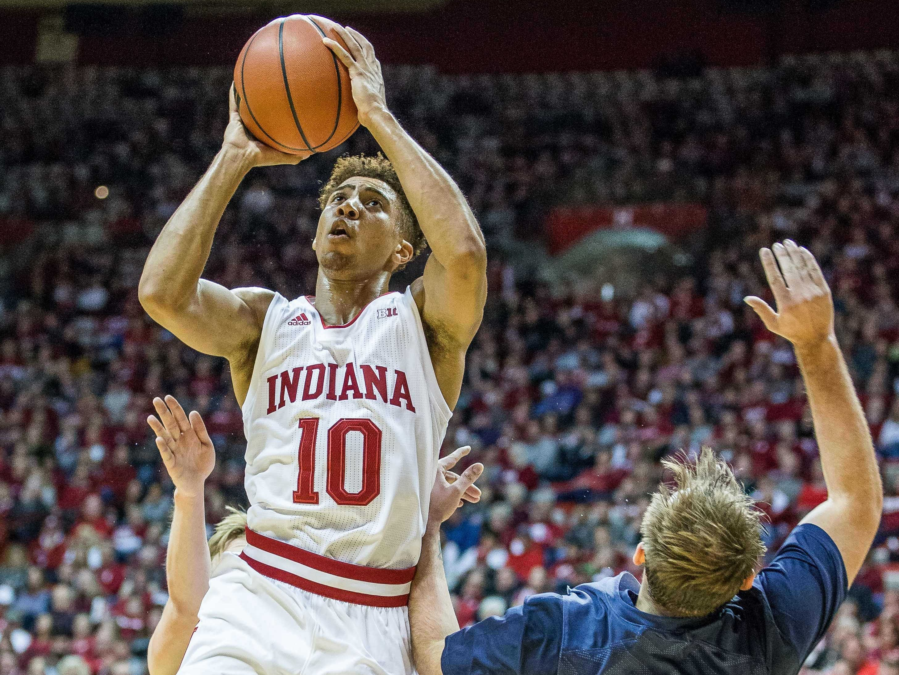Indiana Hoosiers guard Rob Phinisee (10) shoots the ball while Montana State Bobcats center Sam Neumann (4) defends in the first half at Assembly Hall.