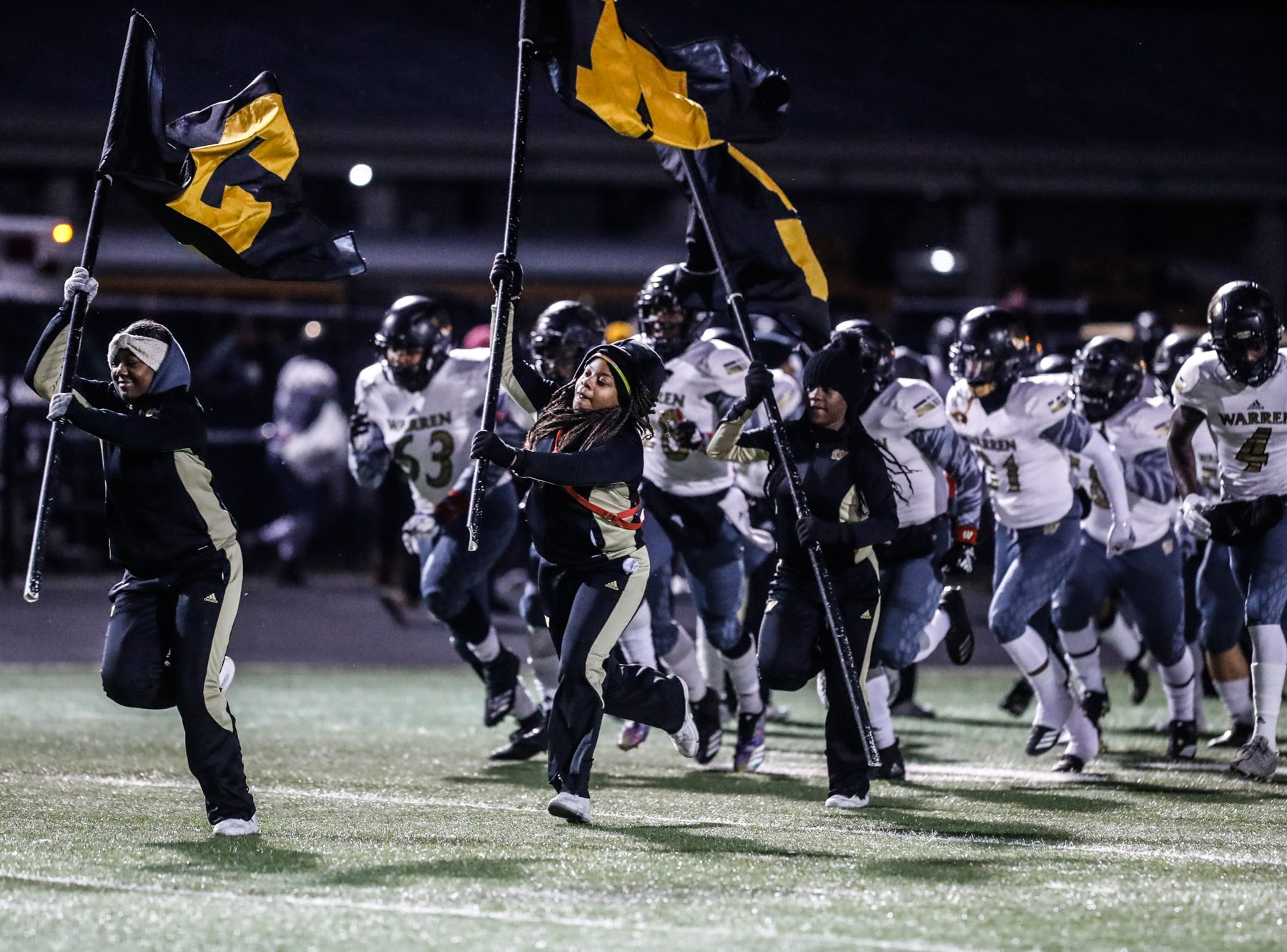 The Warren Central High School Warriors varsity football team takes the field for a regional finals game against the North Central High School Panthers at North Central High School on Friday, Nov. 9, 2018.