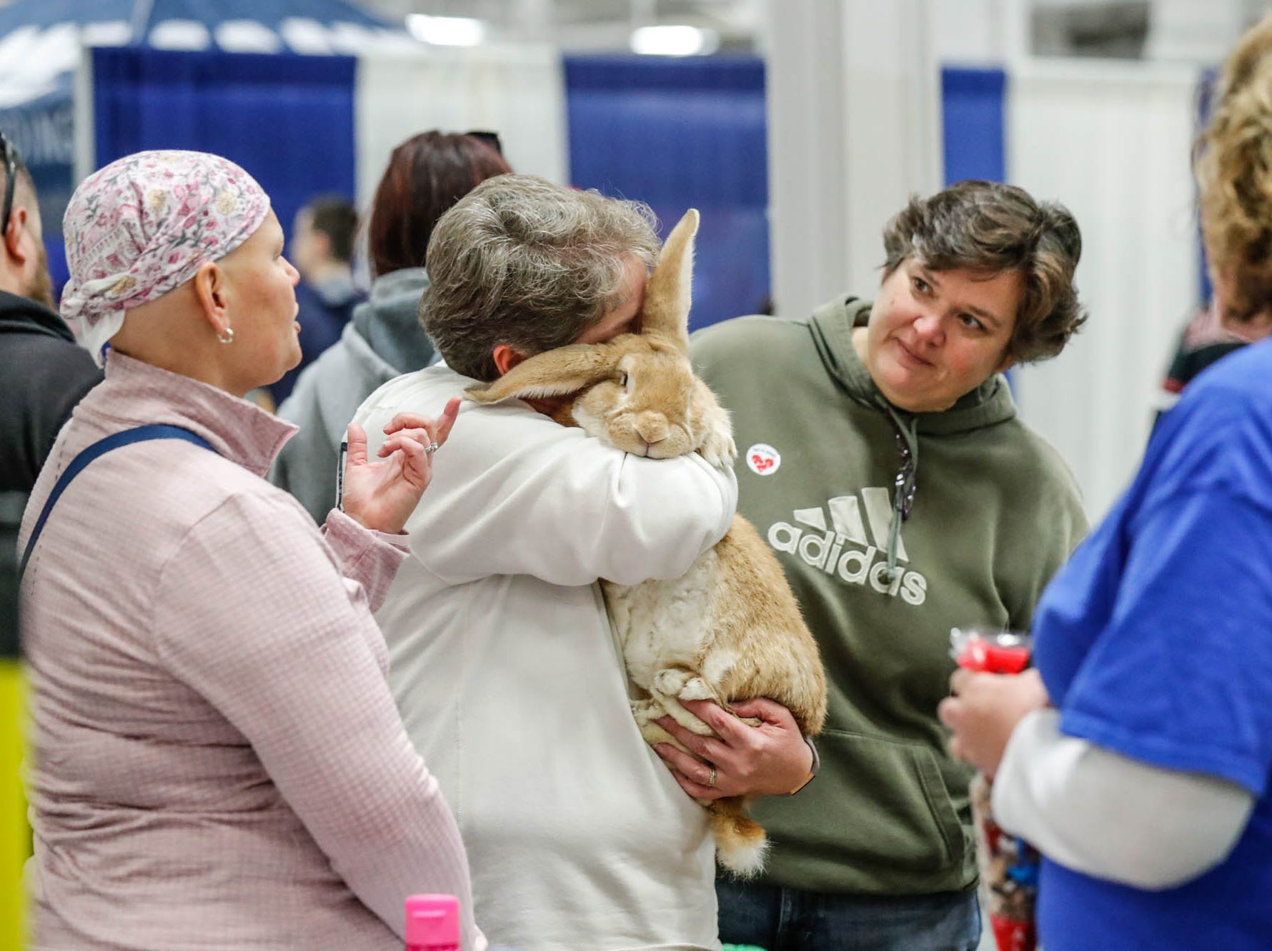 Jane, center, and Rebecca Zieleniuk, right, cuddle a flemish giant rabbit named Ernie at thew Boone County 4-H booth  during the Great Indy Pet Expo, held at the Indiana State Fairgrounds on Sat. Nov. 10, 2018.