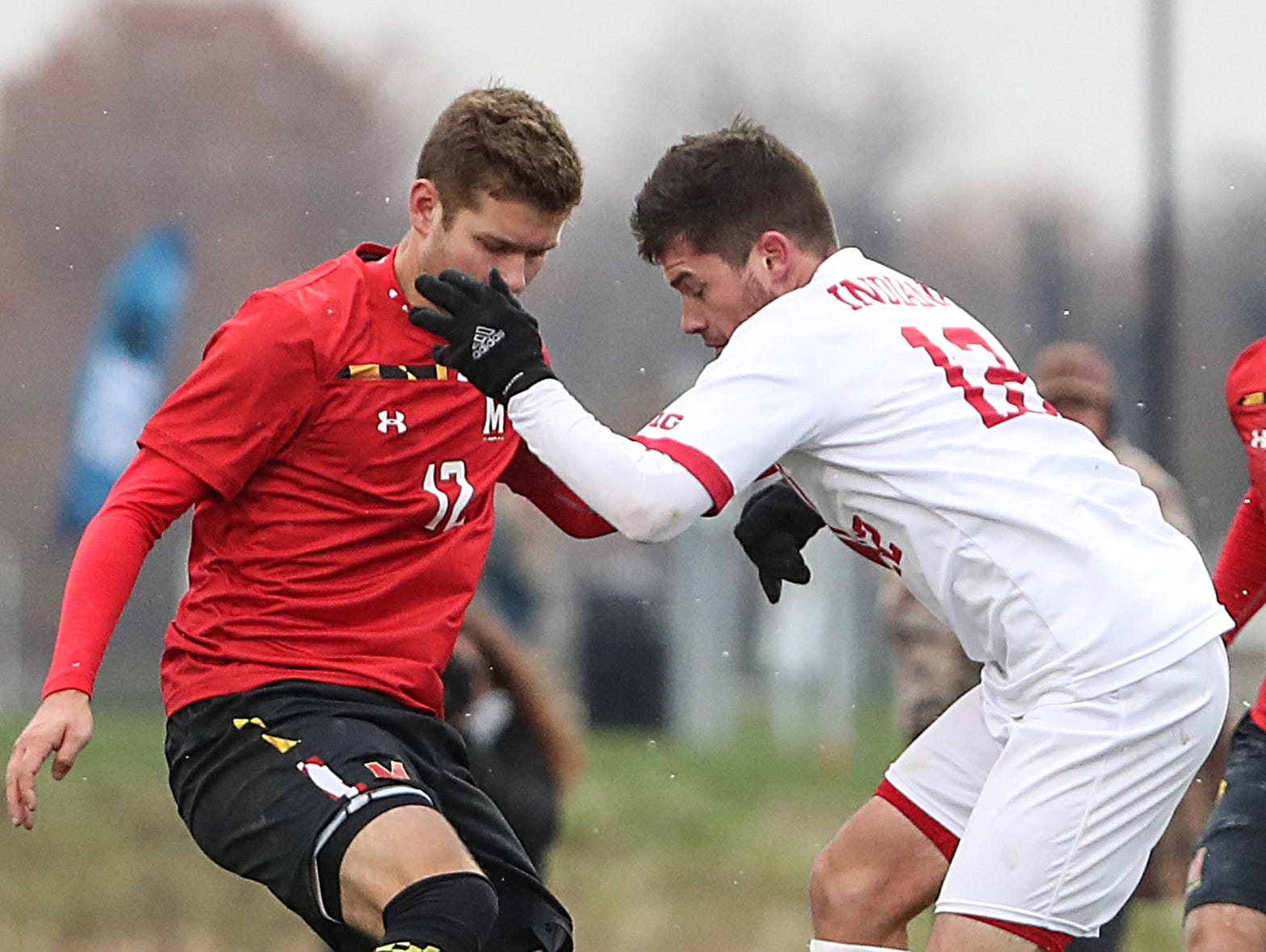 Maryland Terrapins defender Brett St. Martin (12) and Maryland Terrapins defender Brett St. Martin (12) fight for the ball during overtime periods in Big Ten semifinals at Grand Park in Westfield, Ind., Friday, Nov. 9, 2018. Indiana and Maryland tied 1-1, with the Hoosiers advancing in penalty kicks, 4-3.