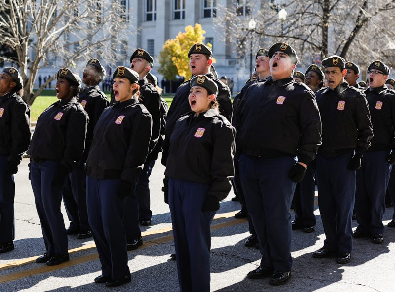 JROTC cadets participate in a call and return during the Veterans Day Parade.