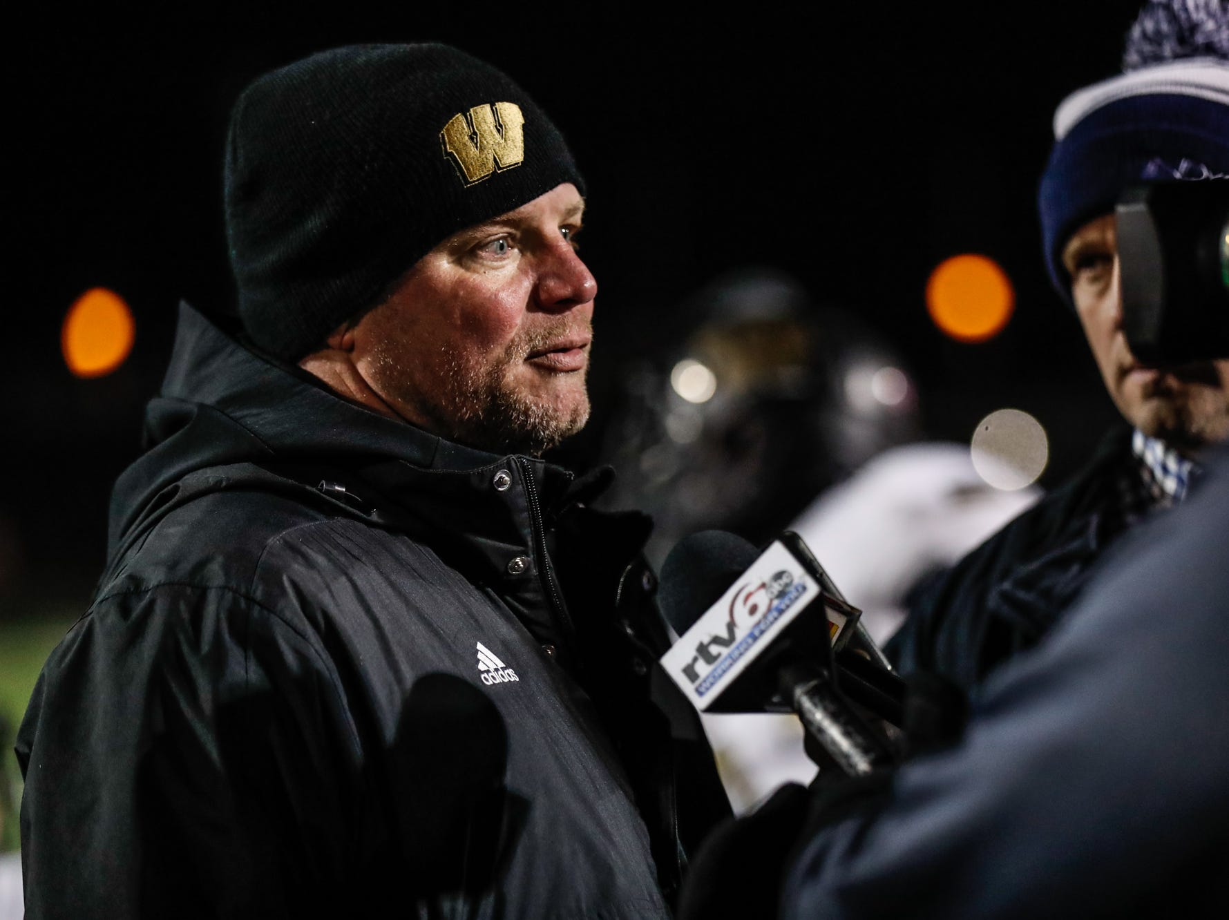 The Warren Central High School Warriors varsity football Coach, Jayson West is interviewed after winning a regional final game against North Central High School Panthers at North Central on Friday, Nov. 9, 2018.