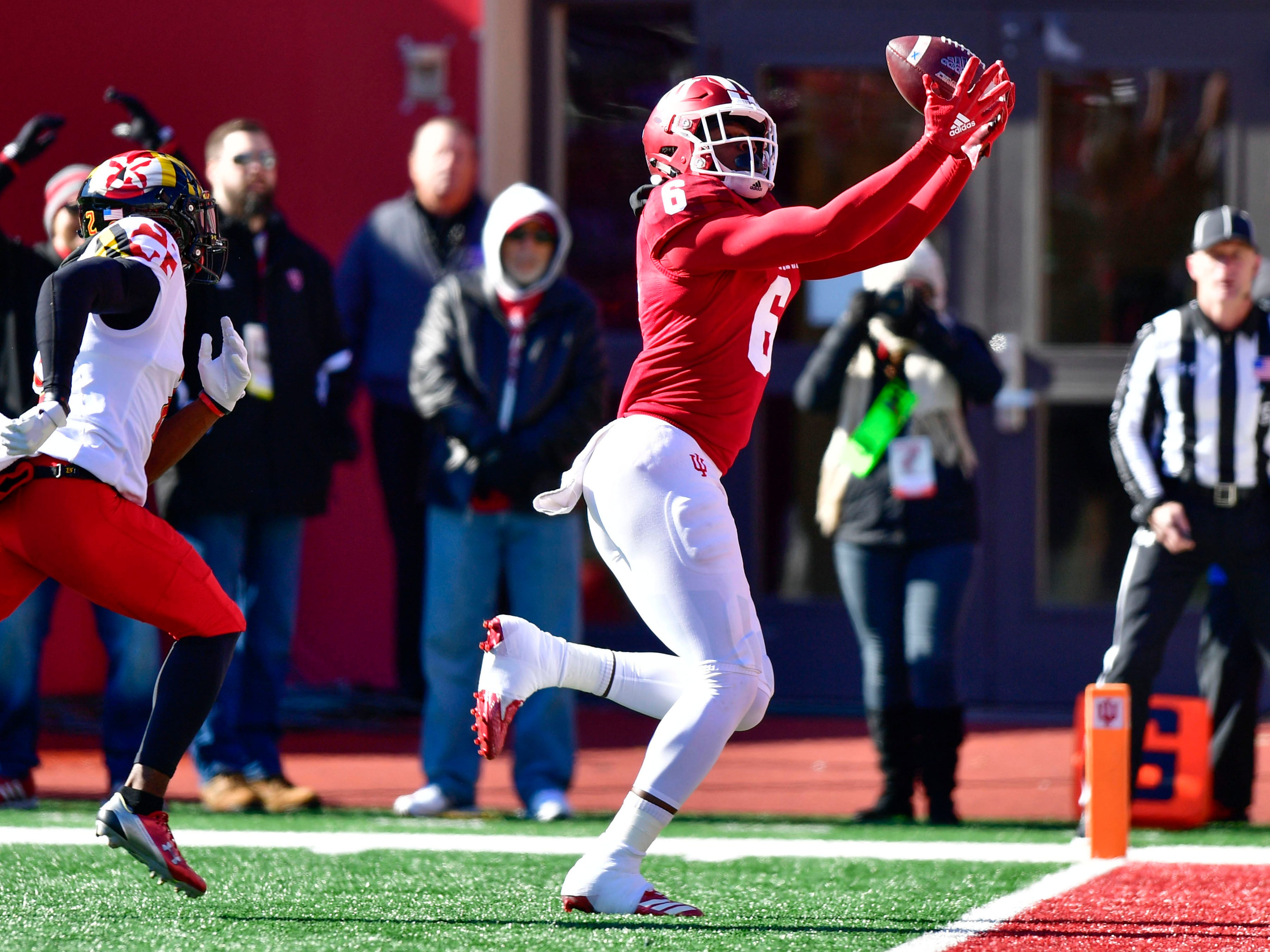 Indiana Hoosiers wide receiver Donavan Hale (6) catches a pass for a touchdown under coverage from Maryland Terrapins defensive back RaVon Davis (2) during the fist half of the the game at Memorial Stadium.