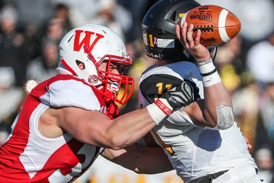 Wabash College linebacker Lucas Bucina (39) sacks DePauw quarterback Chase Andries (11) during the second half of the 125th Monon Bell Classic at Little Giant Stadium in Crawfordsville, Ind., Saturday, Nov. 10, 2018. Wabash defeated DePauw, 24-17.