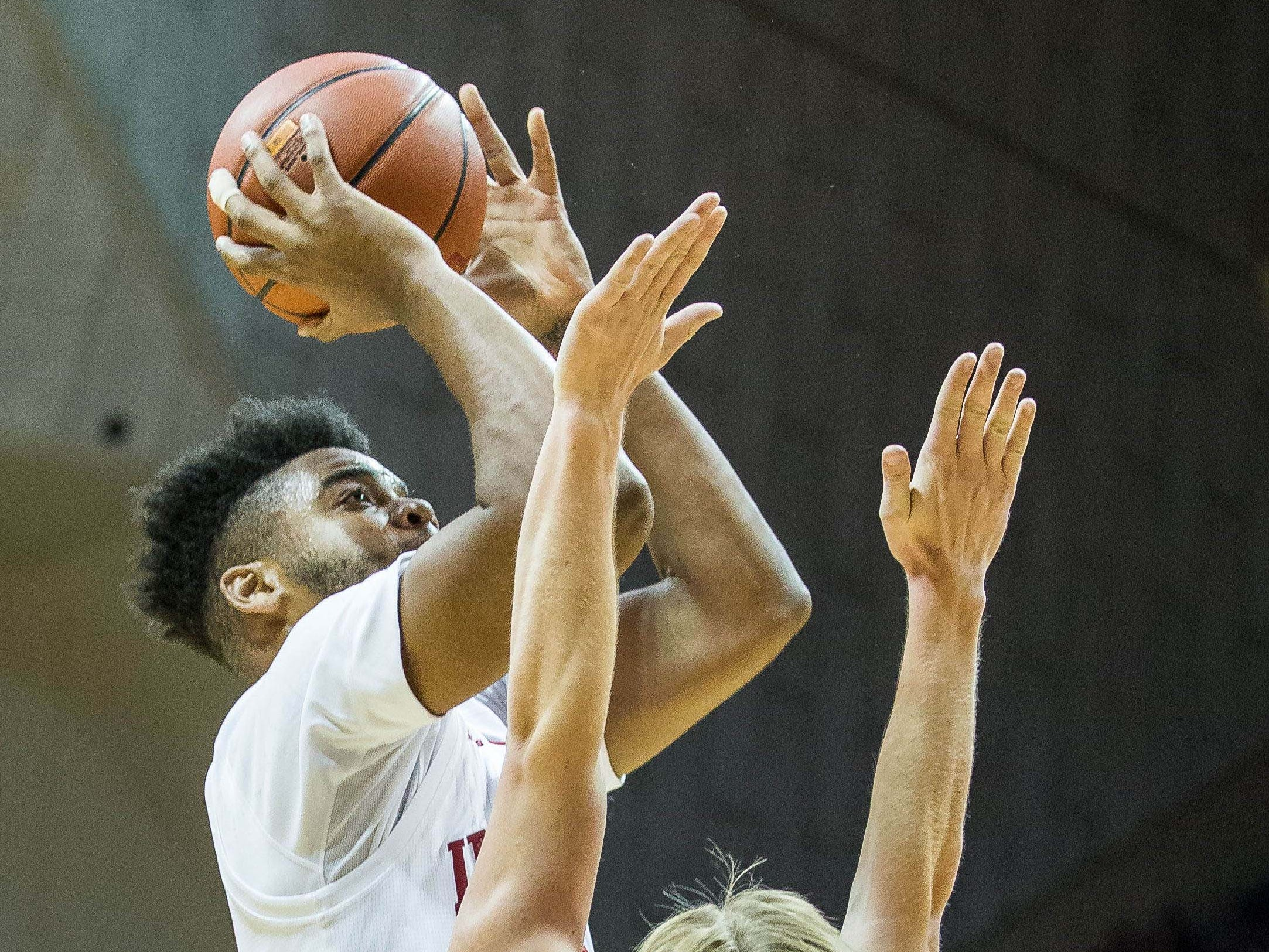 Hoosiers forward Juwan Morgan (13) shoots the ball while Montana State Bobcats guard Harald Frey (5) defends in the first half at Assembly Hall.