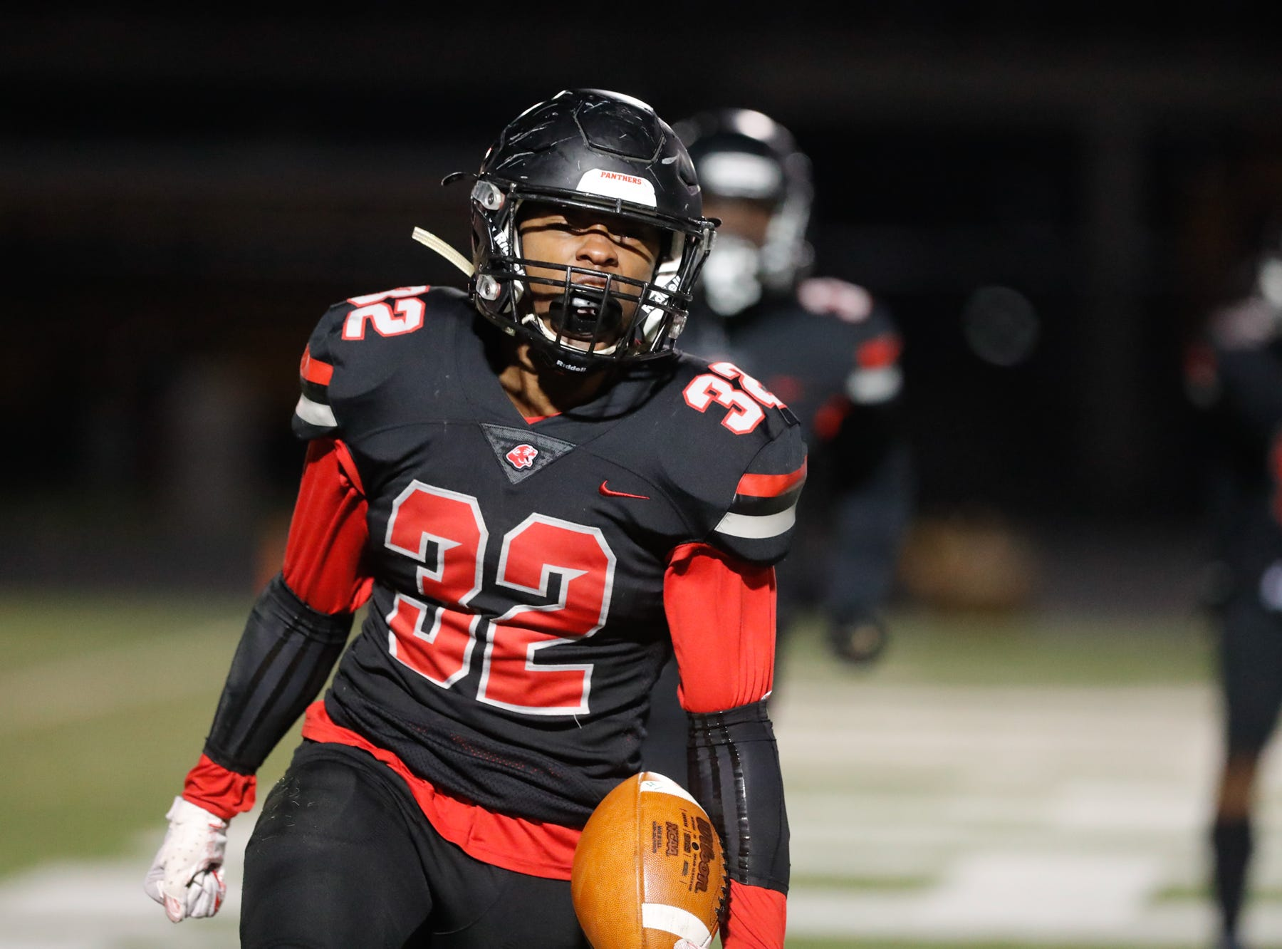 The North Central High School Panther's running back,  Alexander Tarver (32), celebrates a touchdown during a regional finals game against the against the Warren Central High School Warriors at North Central High School on Friday, Nov. 9, 2018.